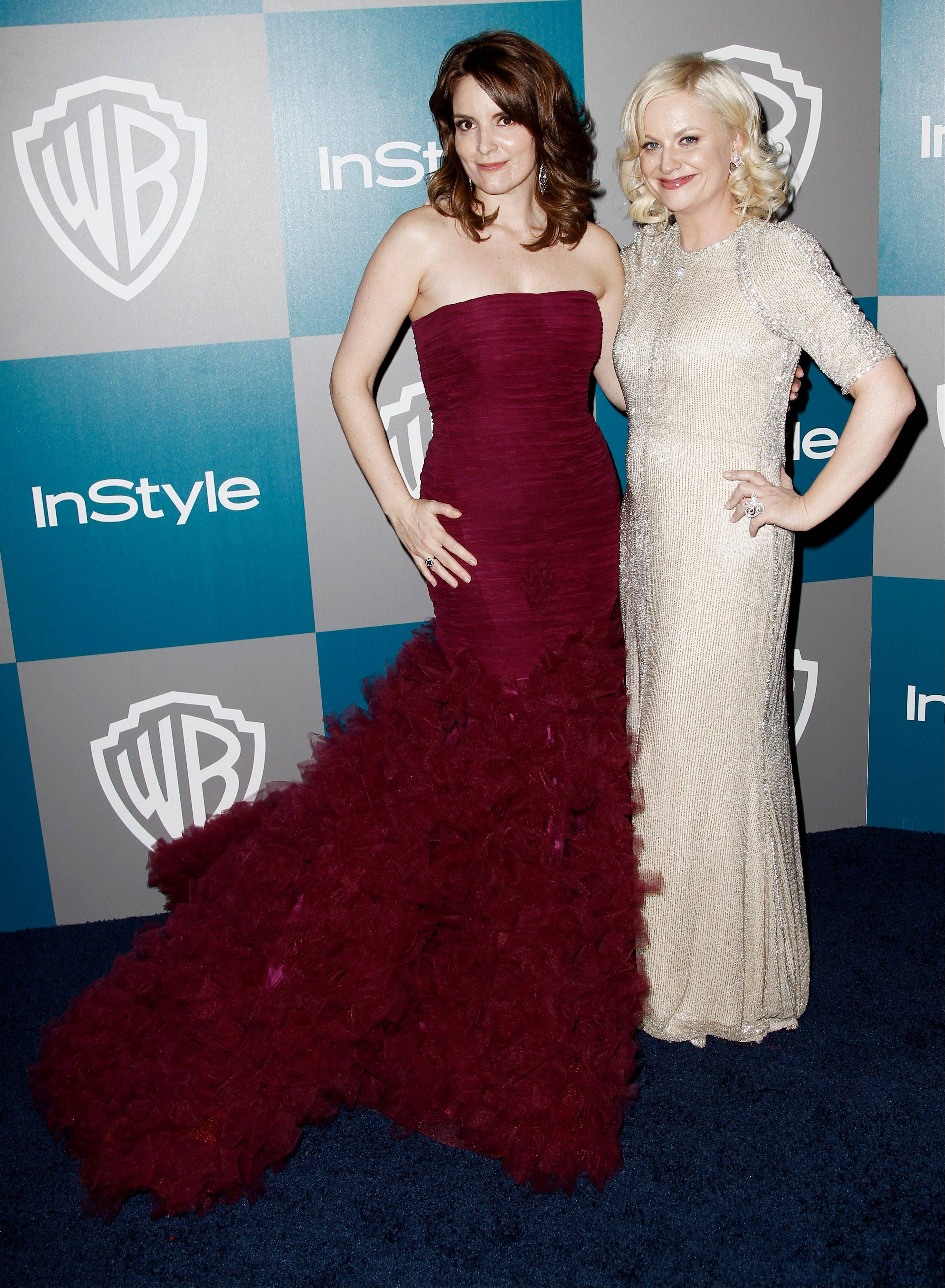"Tina Fey and Amy Poehler are ready to crack each other up at the Golden Globe Awards on Sunday. The two multi-hyphenate talents offered a taste of their quick-witted banter during a conference call with reporters Wednesday, during which Fey promised, ""We're going to sing the whole show."""