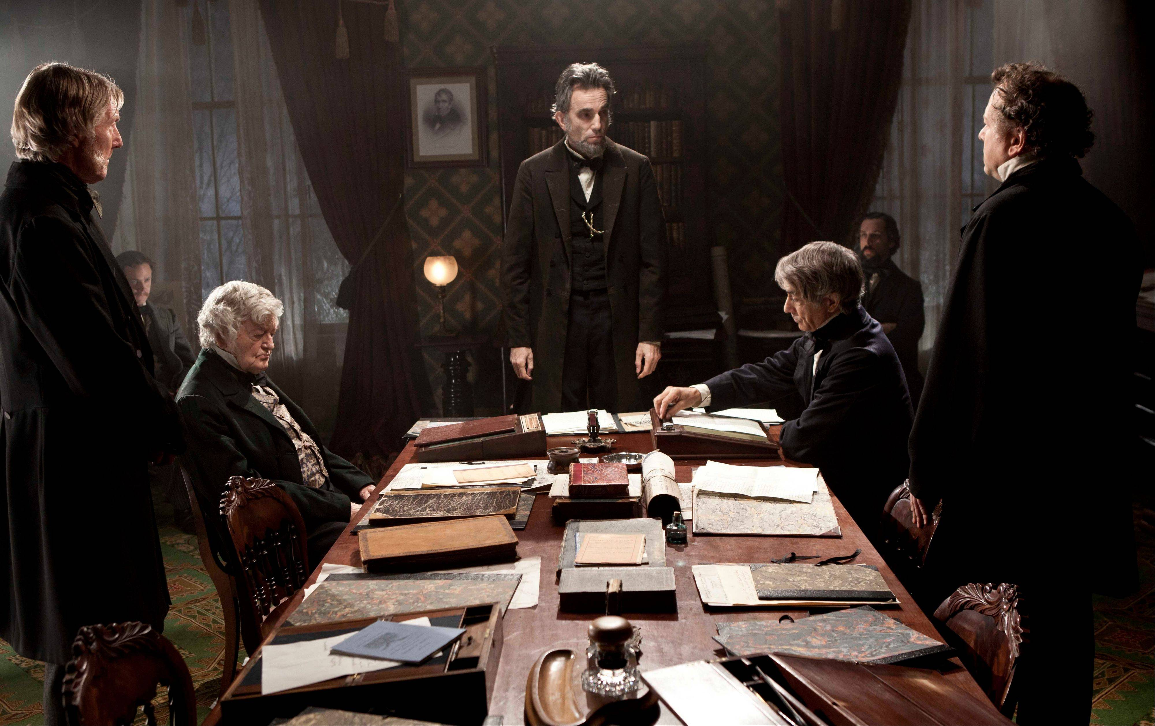 "Daniel Day-Lewis, center, as Abraham Lincoln in the film ""Lincoln,"" is up for best actor at the Golden Globes Sunday."