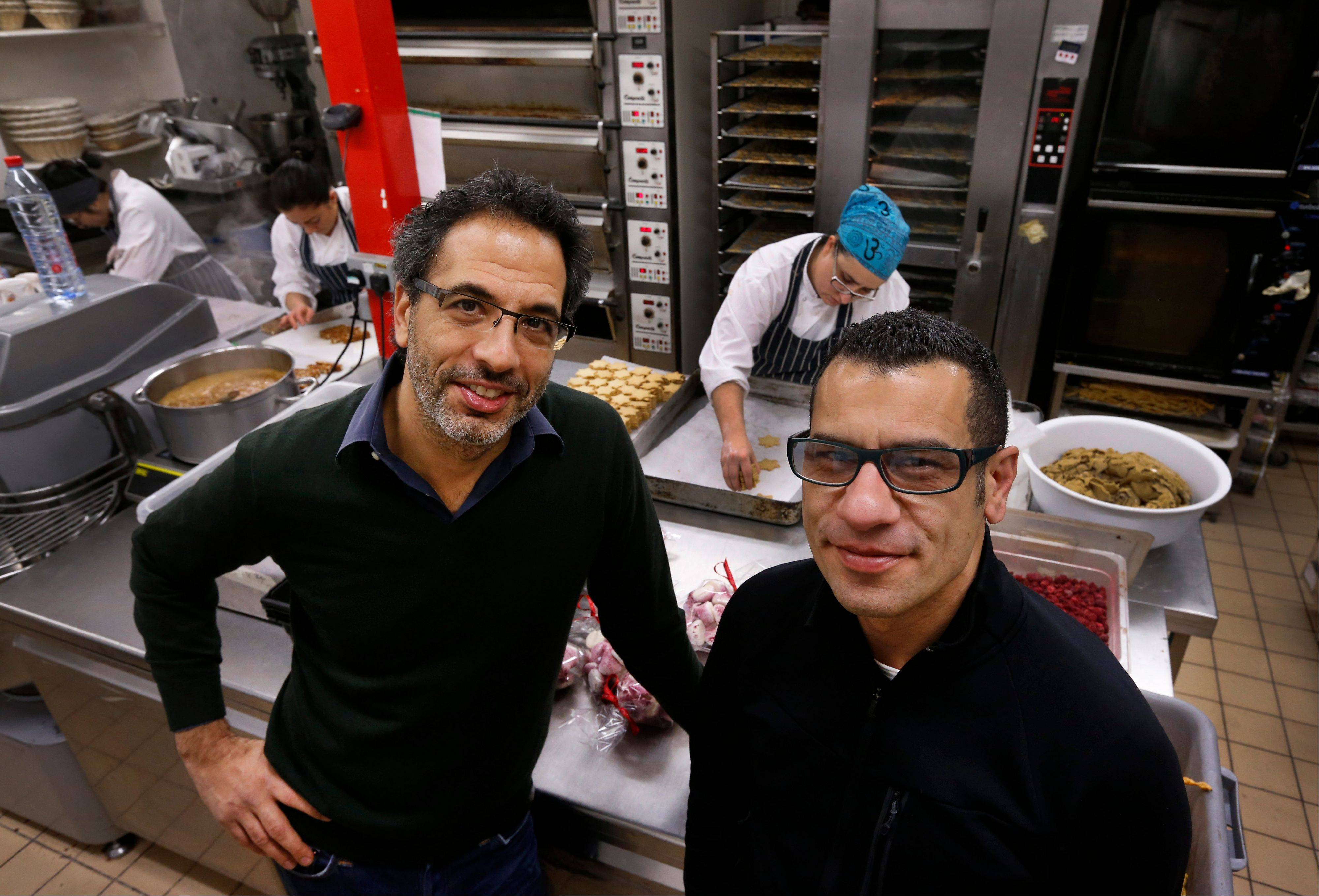 """Jerusalem,"" a cookbook by chefs Yotam Ottolenghi, left, and Sami Tamimi, traces their memories of a shared city, the Jewish west and the Arab east, together with the food -- the commodity held in common in a city filled with division."