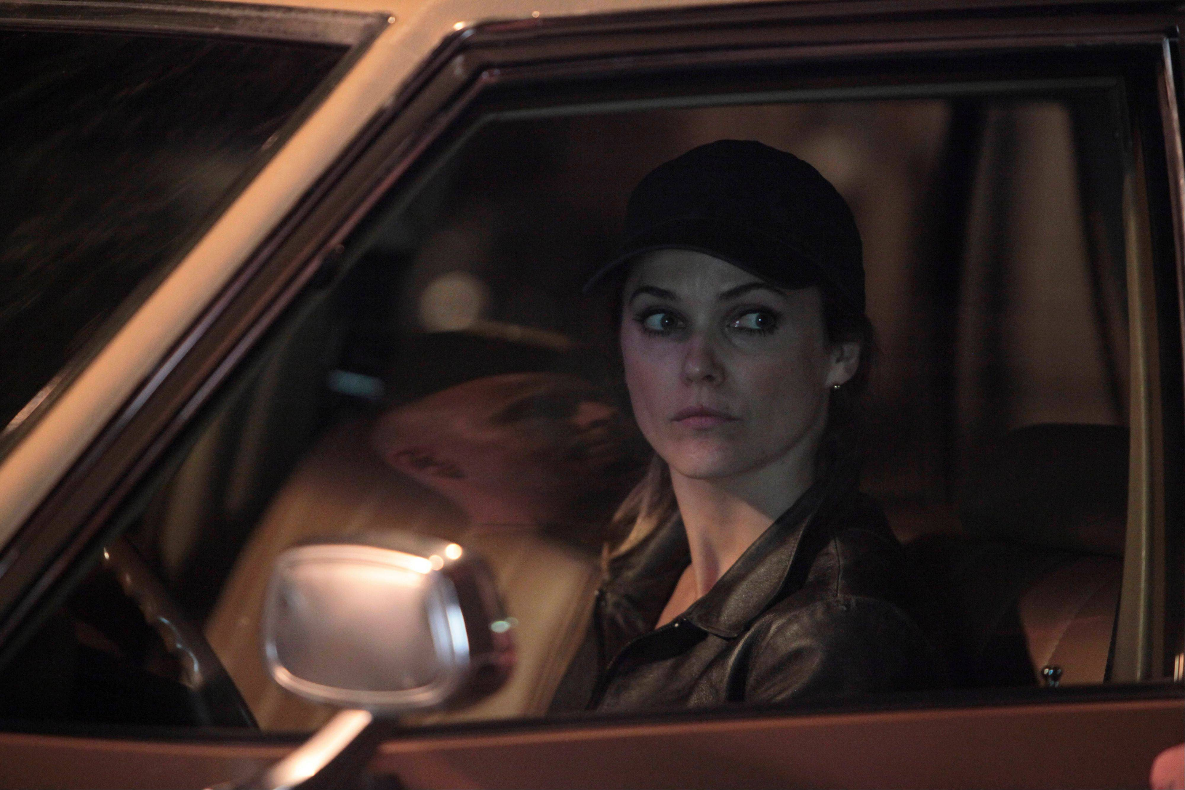 "Elizabeth Jennings (Keri Russell) spies for the Russians while living as a suburban mom in FX's 1980s-set ""The Americans."""