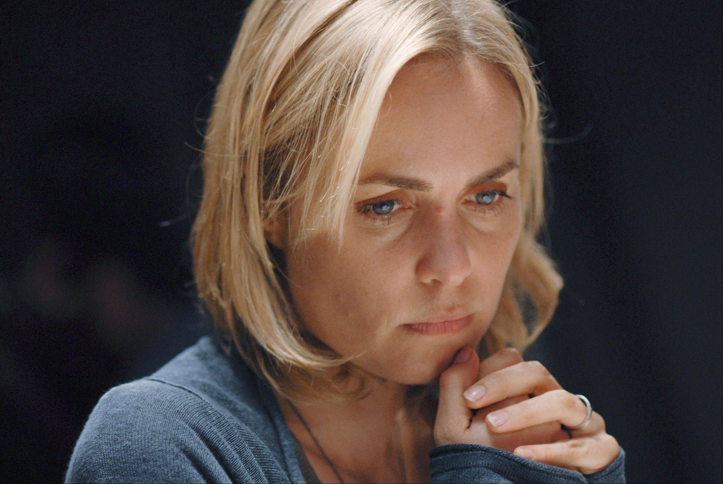 "Marta Walraven (Radha Mitchell) can't escape her family's ties to the Russian mob in ABC's upcoming drama ""Red Widow."""
