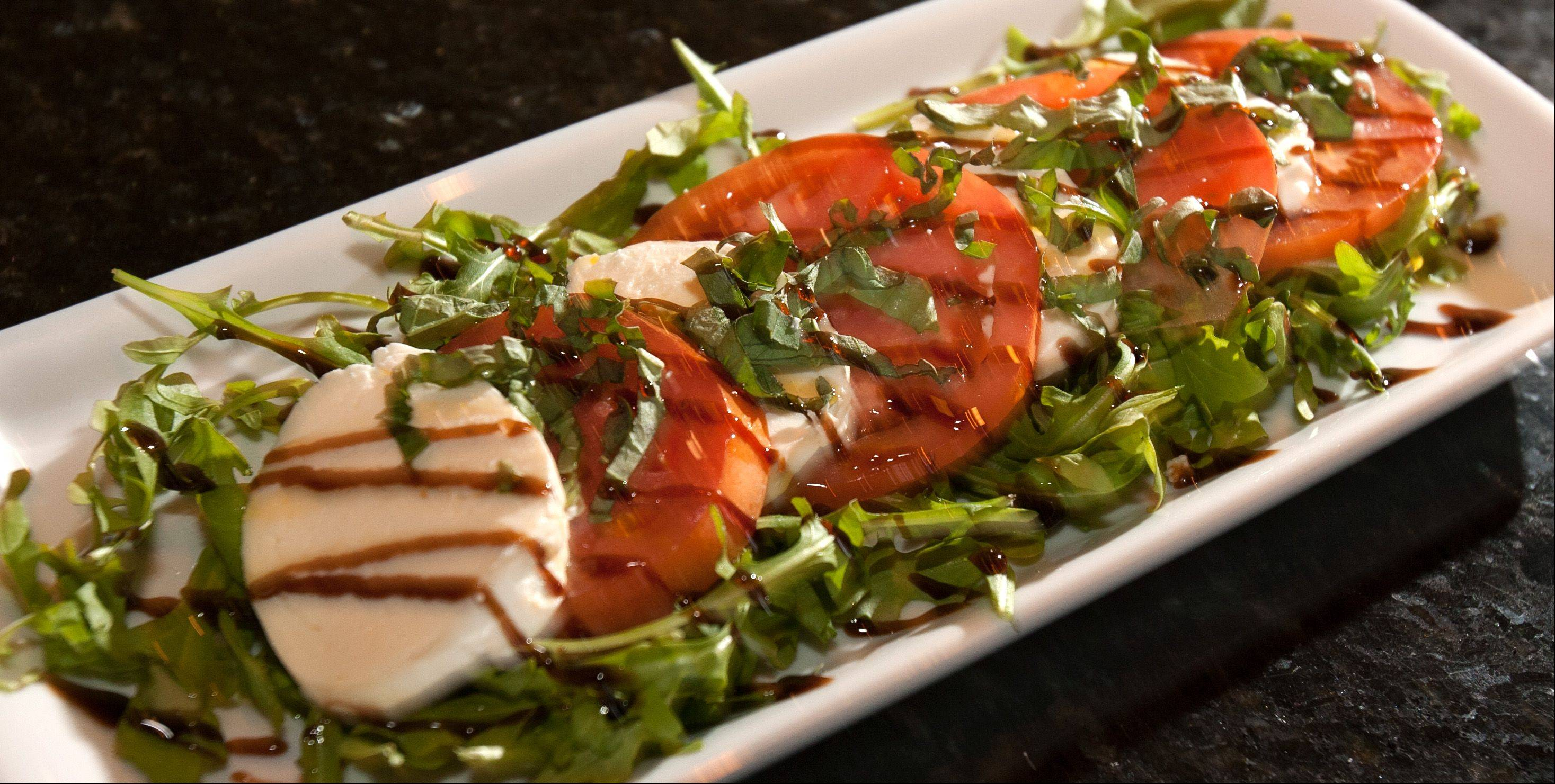 Fiamme's Caprese salad features fresh tomatoes, fresh mozzarella, balsamic reduction and basil.