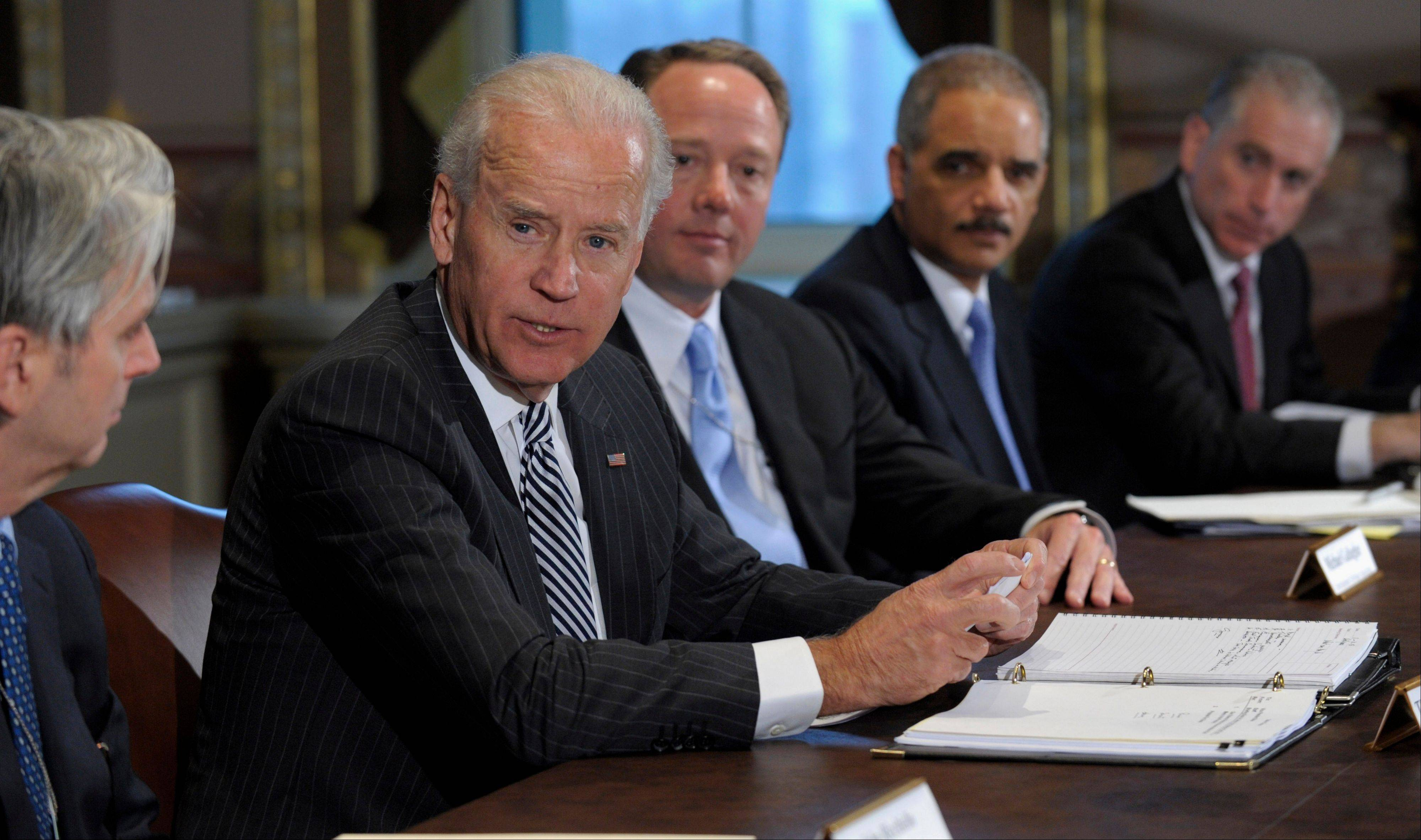 Vice President Joe Biden, second from left, with Attorney General Eric Holder, second from right, speaks Friday during a meeting with representatives from the video game industry in the Eisenhower Executive Office Building on the White House complex in Washington.