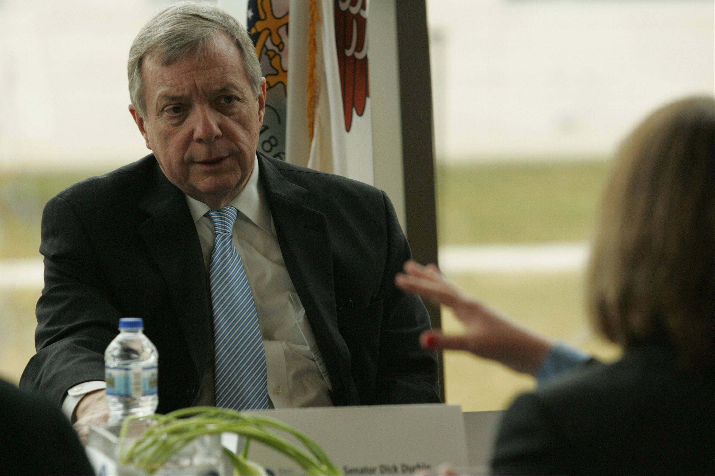 Sen. Dick Durbin listens to Kim Wagner, managing director of student financial services at ECC, as she describes the school's policy of helping students deal with loans and student debt.