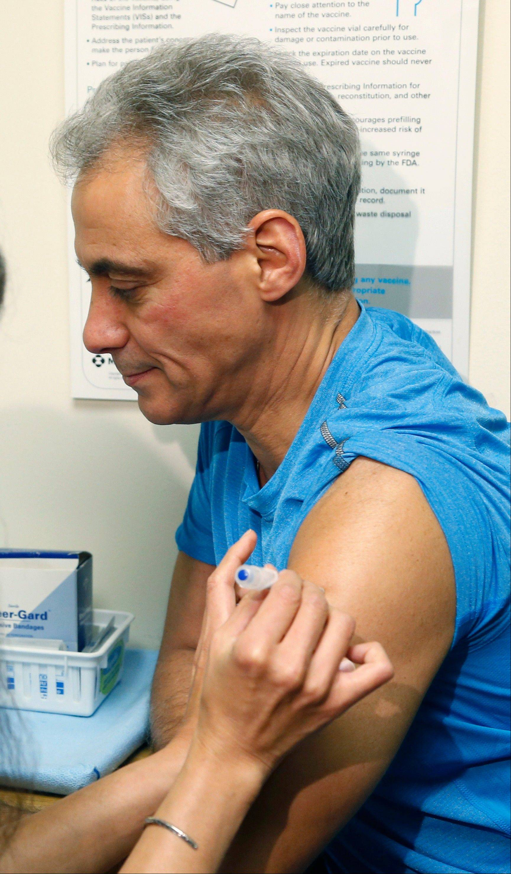 Chicago Mayor Rahm Emanuel receives a flu shot Friday from Dr. Julie Morita, director of immunizations for the Chicago Department of Public Health, at a North Side clinic.