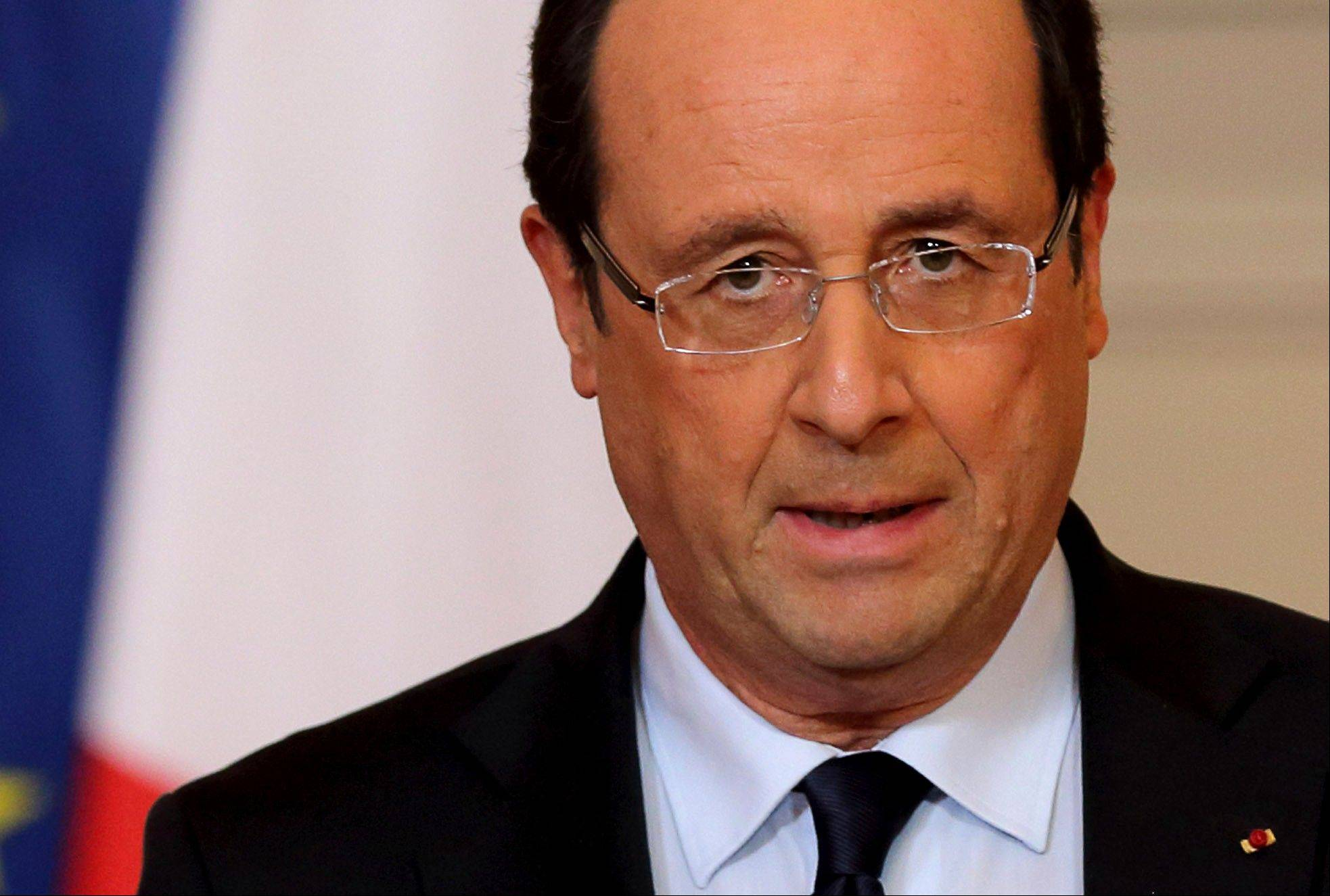 France's President Francois Hollande delivers a speech Friday on the situation in Mali at the Elysee Palace in Paris.