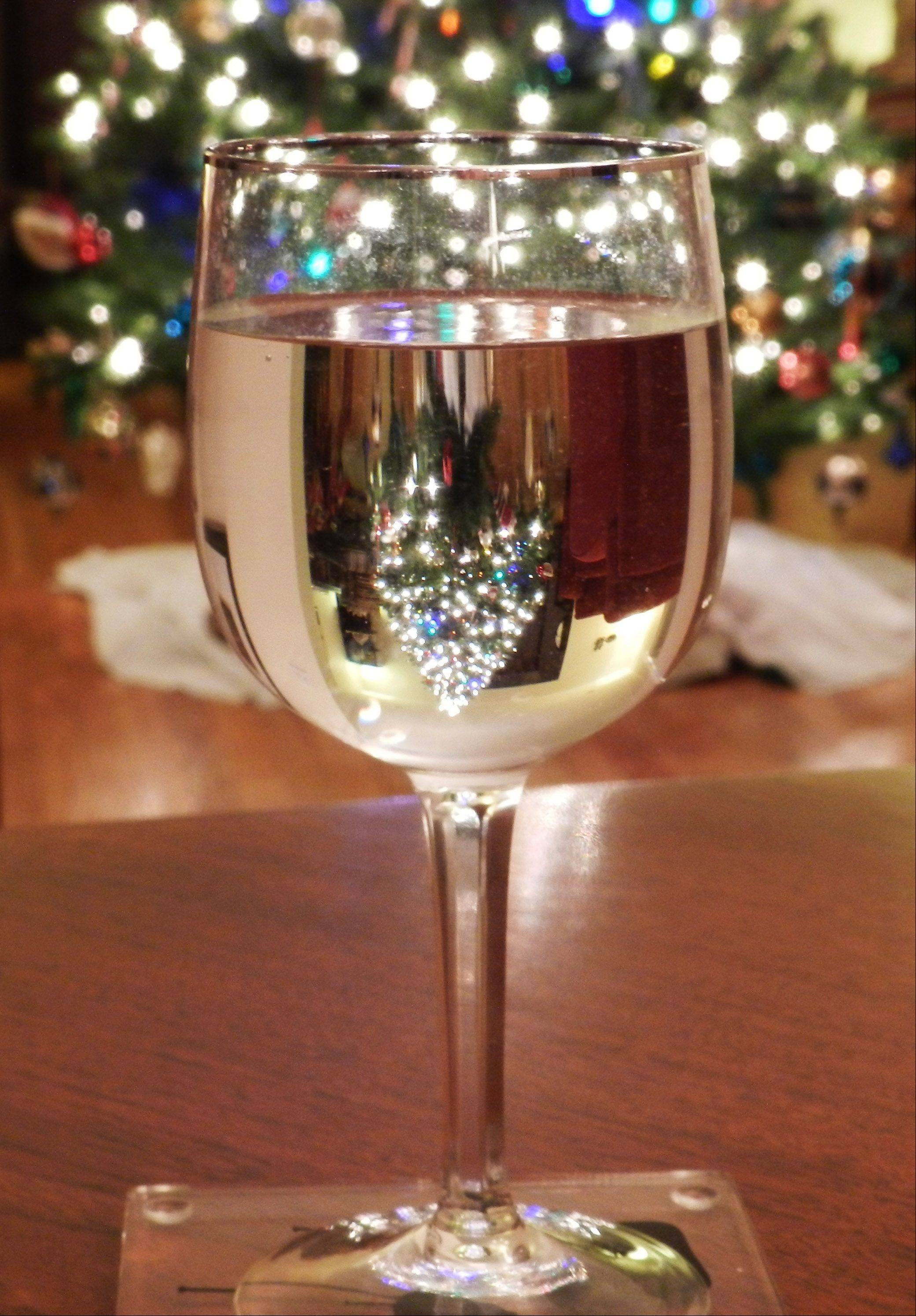 This Christmas tree through a water glass, was taken after clearing the dining room table from Christmas dinner.