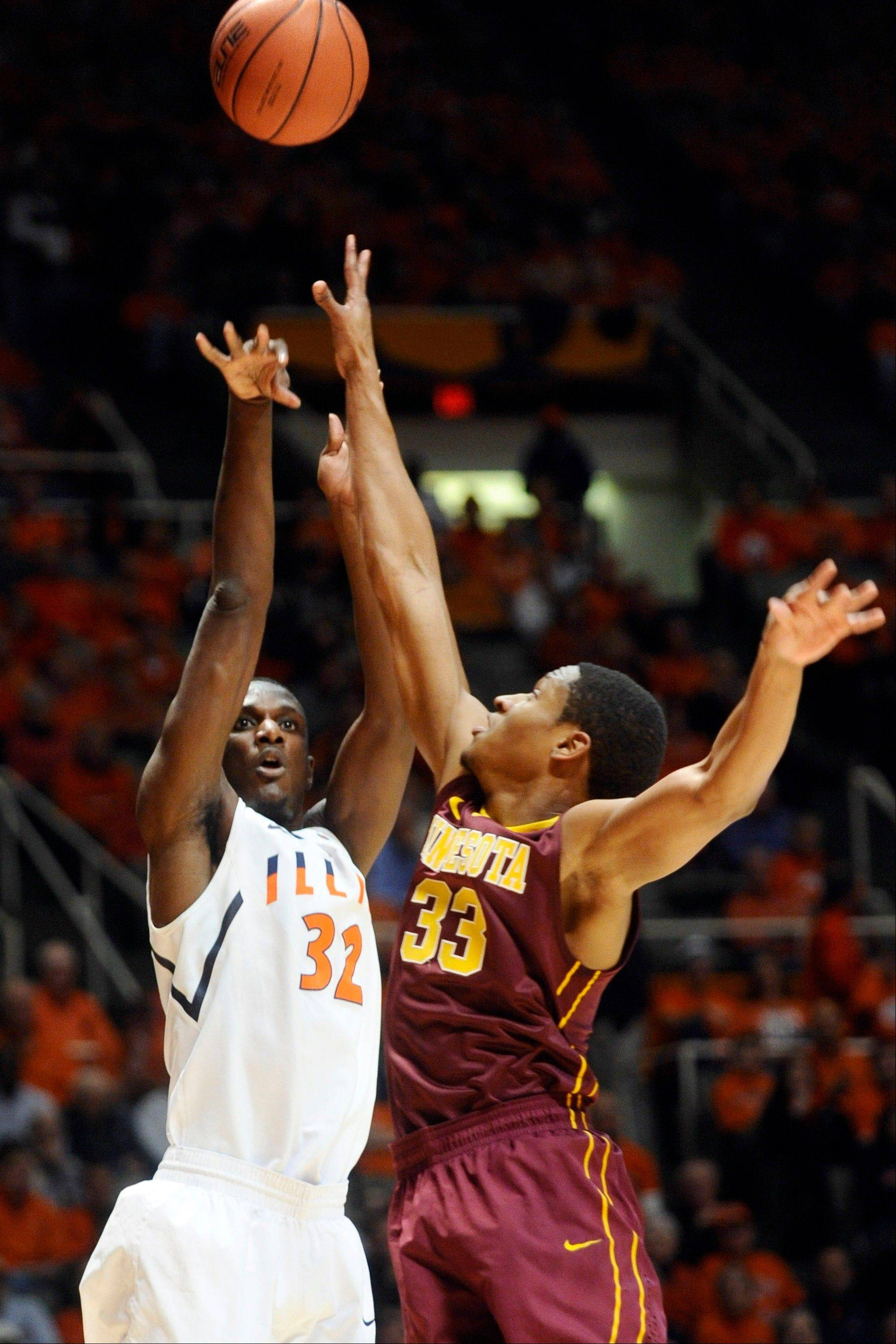 Illinois' Nnanna Egwu (32) shoots as Minnesota forward Rodney Williams (33) defends during their NCAA college basketball game, Wednesday, Jan. 9, 2013, in Champaign.