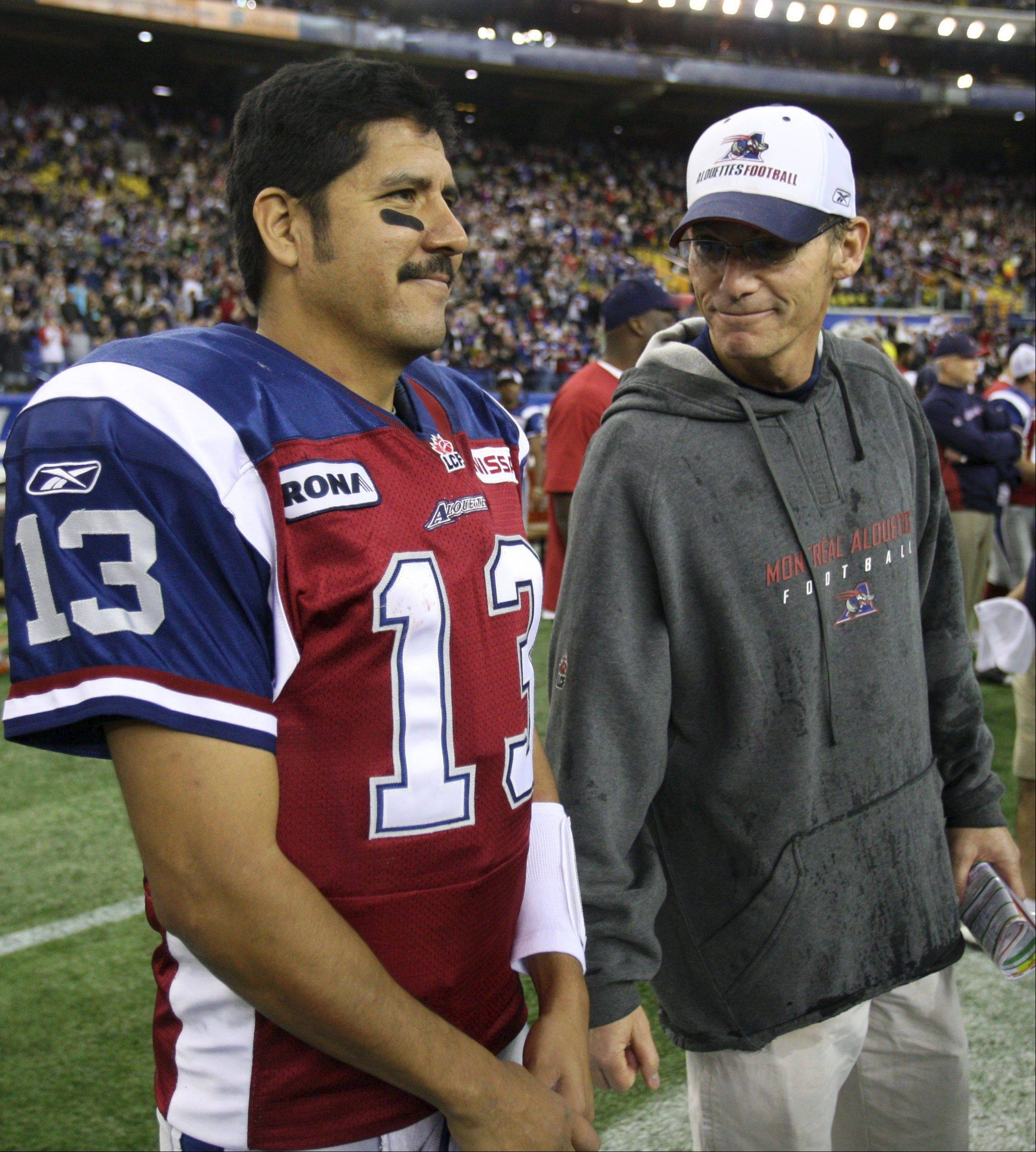 Montreal Alouettes head coach Mark Trestman, here with quarterback Anthony Calvillo, has denied a report that he has been offered the Bears' head coaching job. NFL analyst Jimmy Johnson, who worked with Trestman at Miami, tweeted that Trestman will be getting the job in Chicago.