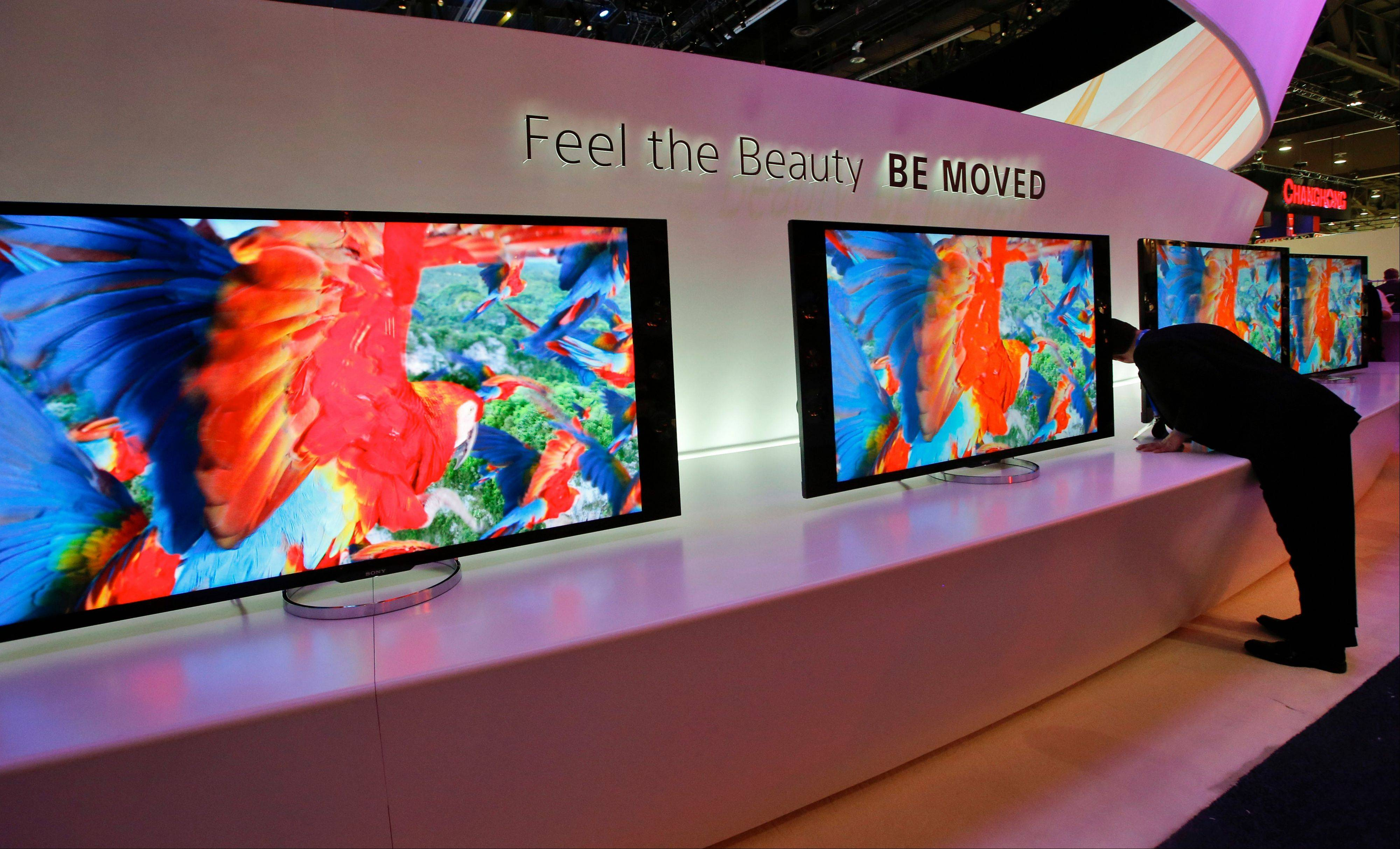 Associated Press Vito Anzalone, far right, looks at the back of Sony�s 4K XBR LED televisions at the Sony booth during a news conference at the International Consumer Electronics Show in Las Vegas, Monday.
