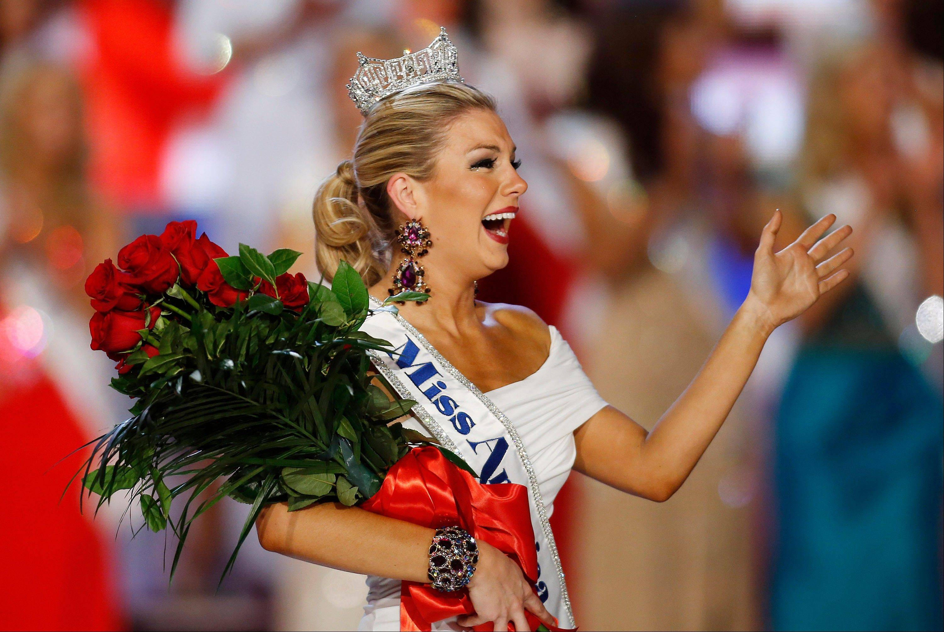 Miss New York Mallory Hagan waves after she was crowned Miss America 2013 on Saturday, Jan. 12, 2013, in Las Vegas.