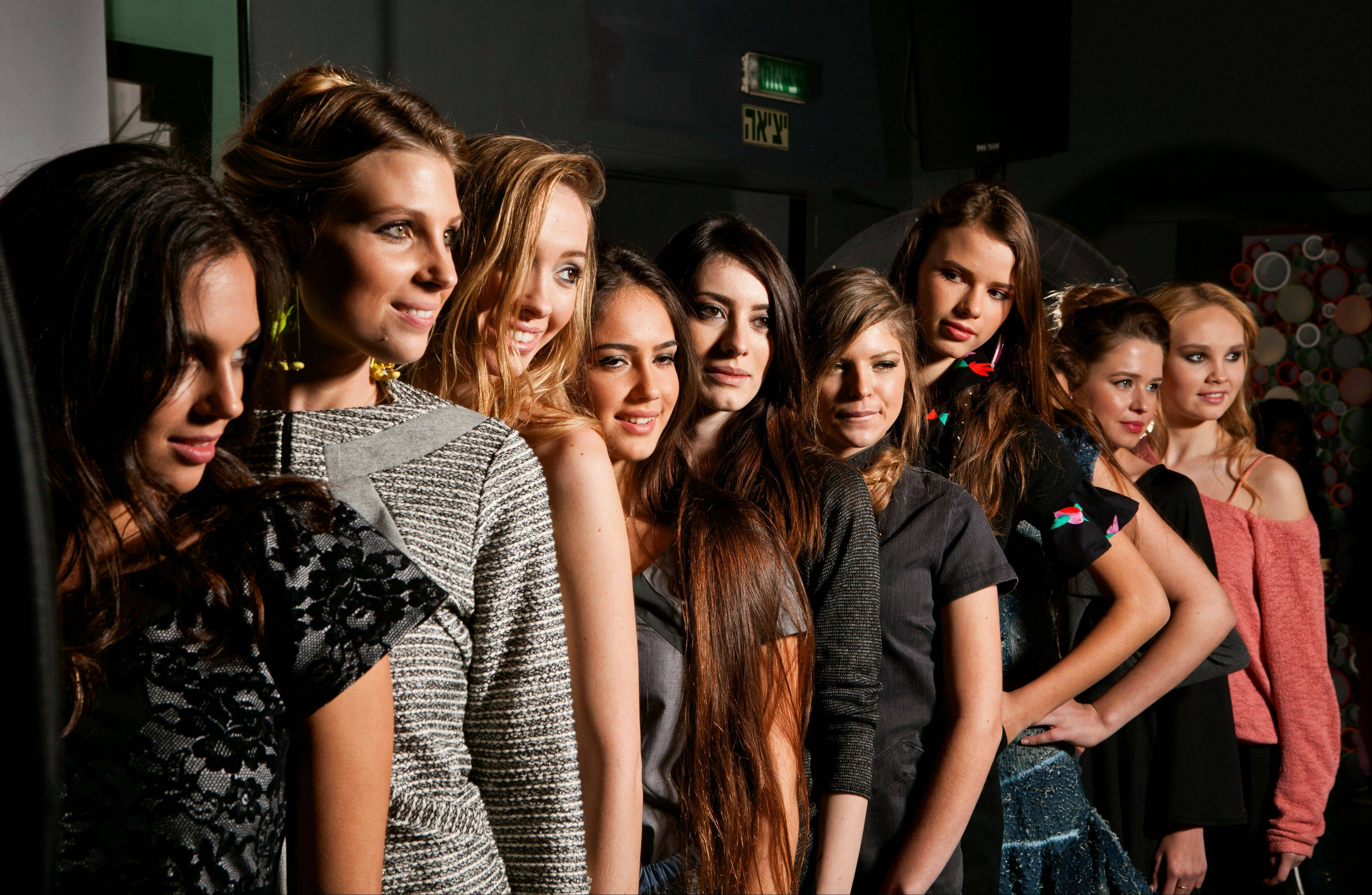 Models stand in line Tuesday for a fashion shoot in Ramat Hasharon, Israel. A new Israeli law prohibits the employment of underweight fashion models. The new law requires models to produce a medical report no older than three months at every shoot for the Israeli market, stating that they are not malnourished by World Health Organization standards.