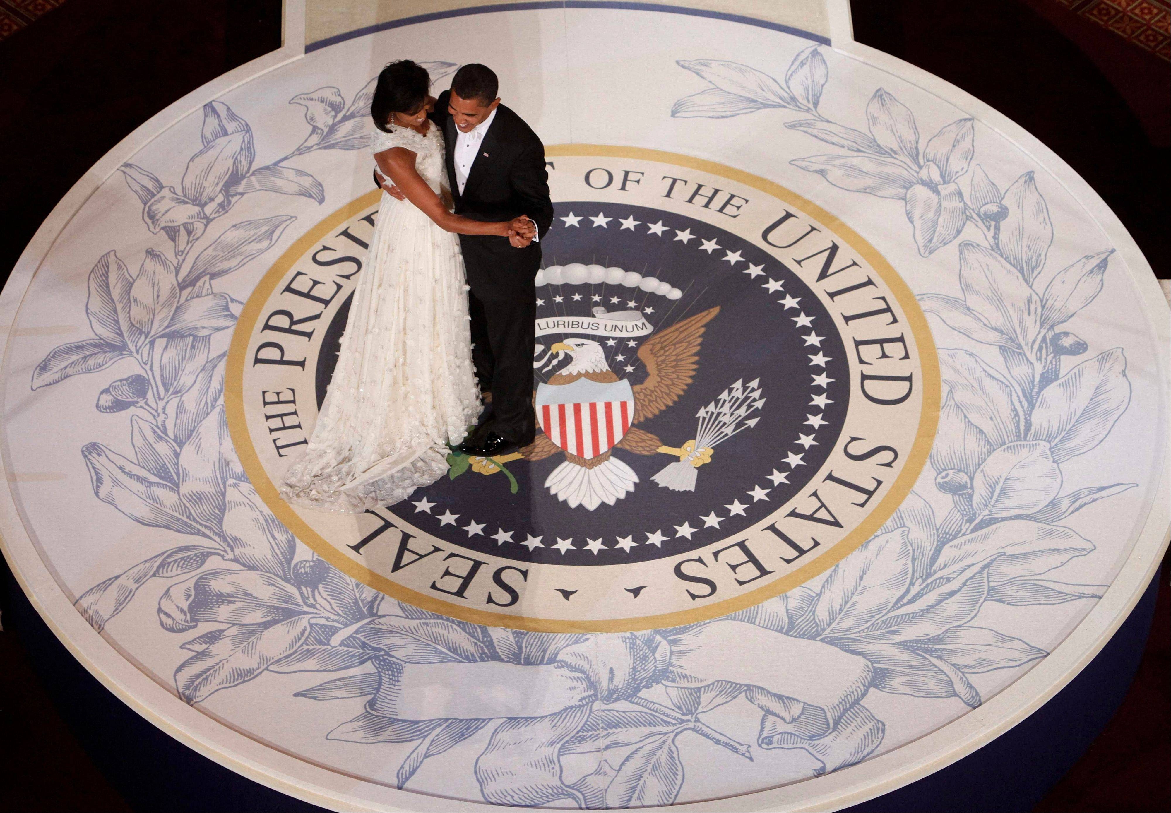 President Barack Obama and first lady Michelle Obama dance at the Commander in Chief Inaugural Ball at the National Building Museum in Washington.