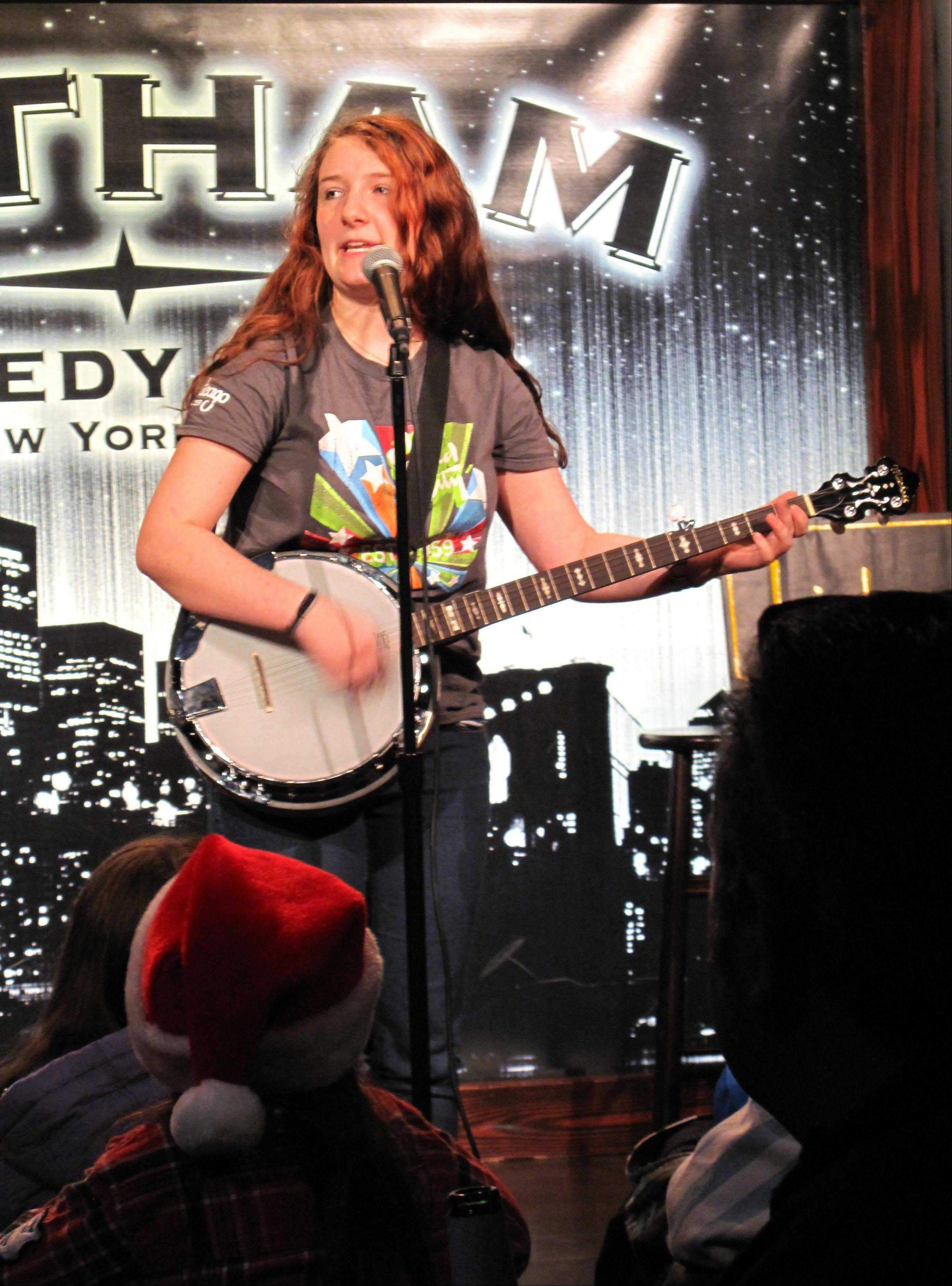 Teenage comedian Val Bodurtha plays banjo and sings a song chastising classmates who tout views on social issues and politics during the �Kids �N Comedy� show at the Gotham Comedy Club in New York.