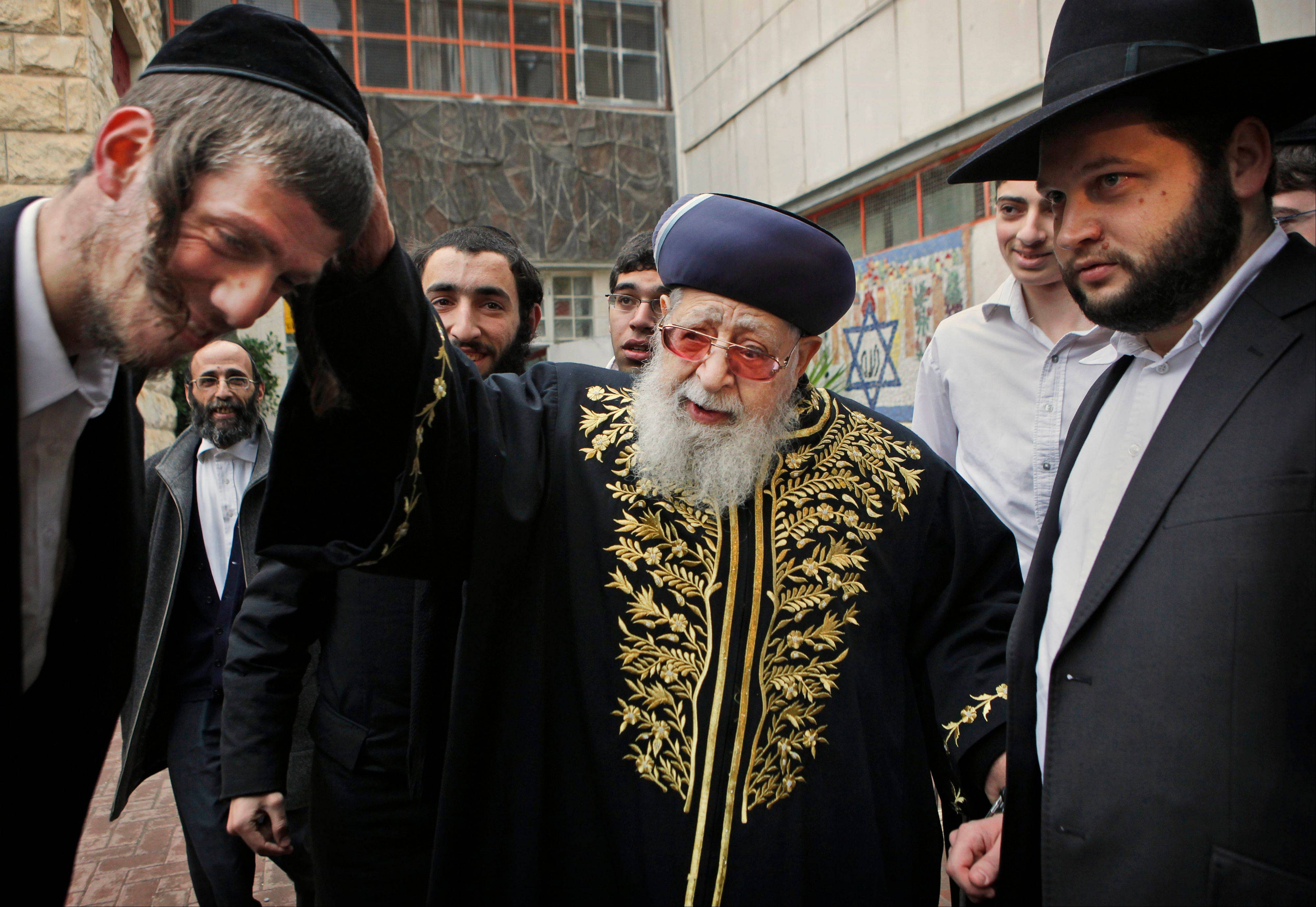 Associated Press/Feb. 10, 2009 Rabbi Ovadia Yosef, center, Jewish spiritual leader of Israel�s Shas party, blesses a man after casting his ballot at a polling station in Jerusalem.
