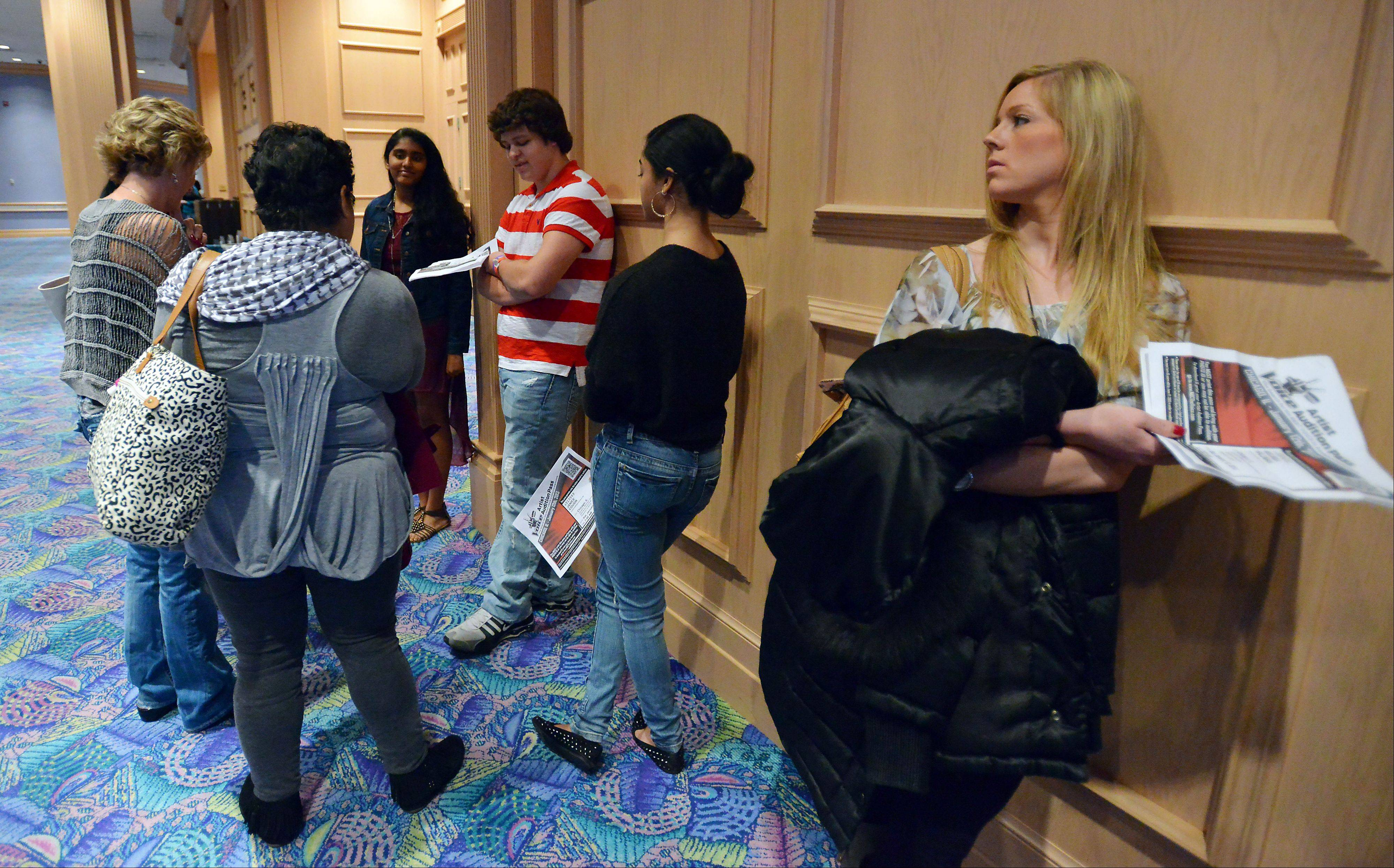 "Melissa Hallman, 25, of Barrington stands in one of many lines during Saturday morning auditions for NBC's ""The Voice"" at the Donald E. Stephens Convention Center. She did not make it to the next round."