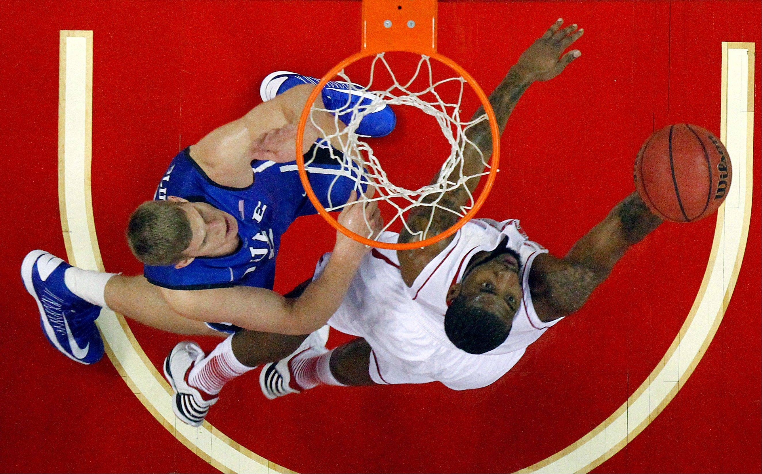 CORRECTS FIRST NAME TO MASON, NOT MARSHALL - North Carolina State's Richard Howell (1) shoots the ball over Duke's Mason Plumlee (5) during the first half of an NCAA college basketball game in Raleigh, N.C., Saturday, Jan. 12, 2013. Howell scored 16 points in State's 84-76 win over No. 1 Duke. (AP Photo/Karl B DeBlaker)