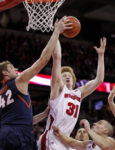 Jared Berggren scored 15 points and grabbed a season-high 12 rebounds, and Traevon Jackson added a career-best 14 points to lead Wisconsin over No. 12 Illinois 74-51 Saturday. The Badgers (12-4, 3-0 Big Ten) scored the game's first 14 points and led by 20 at halftime on the way to their sixth straight win.