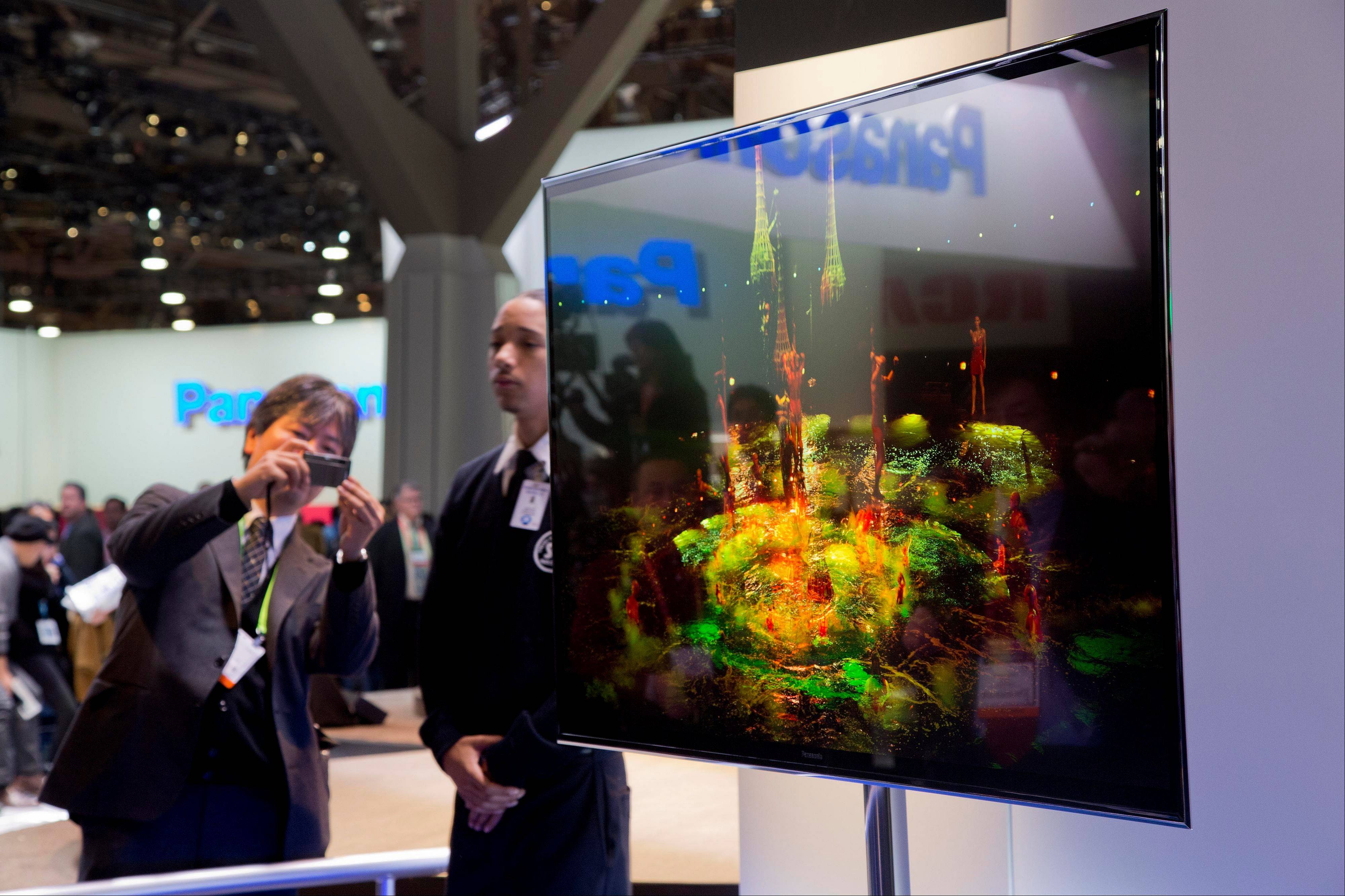 Industry affiliates photograph Panasonic's 4K OLED large screen television Tuesday at the Consumer Electronics Show in Las Vegas.