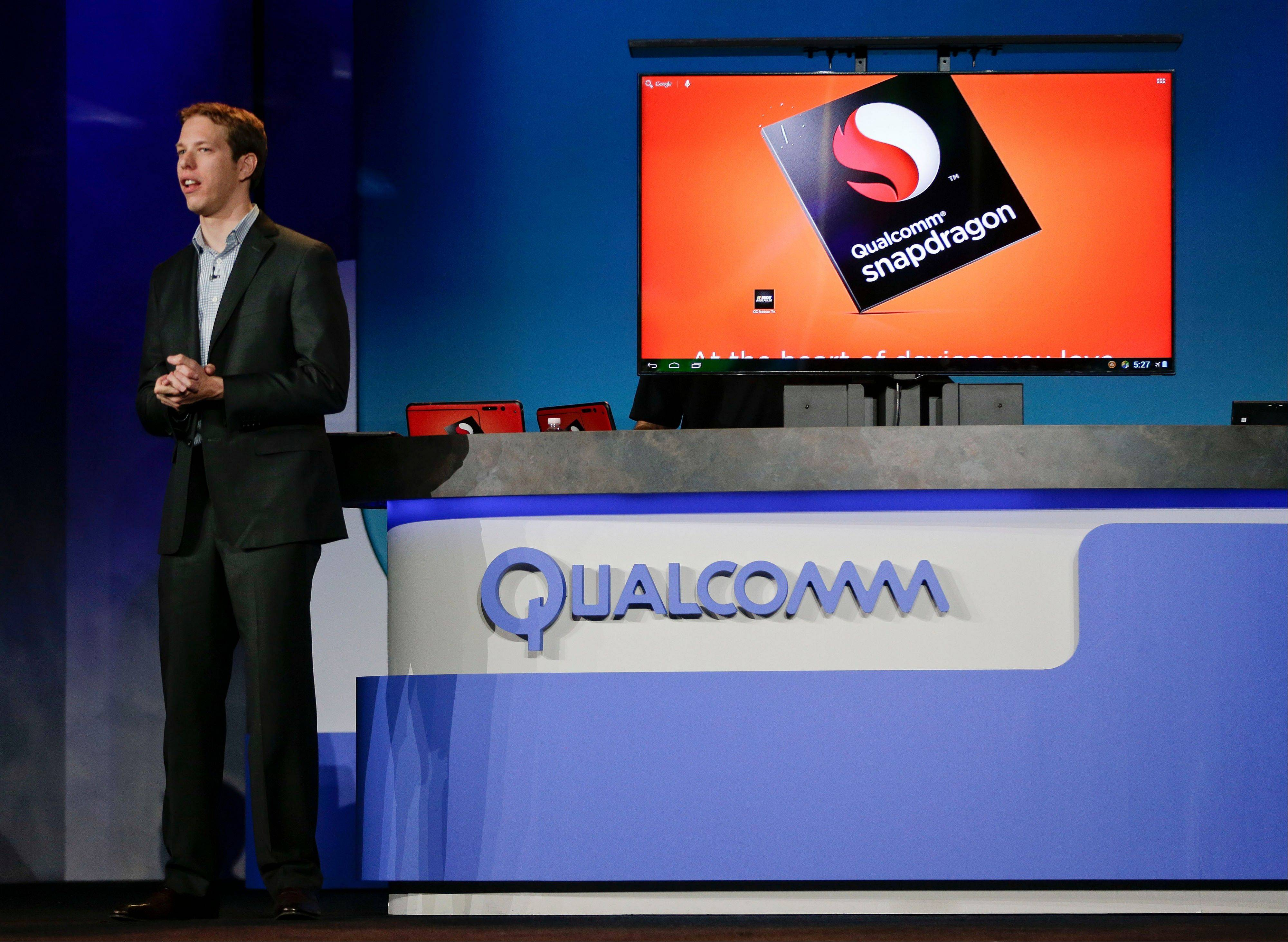 NASCAR Sprint Cup Series 2012 champion Brad Keselowski talks about Snapdragon technology used in mobile devices and applications for fans to use during the keynote address by Qualcomm CEO Paul Jacobs at the Consumer Electronics Show.