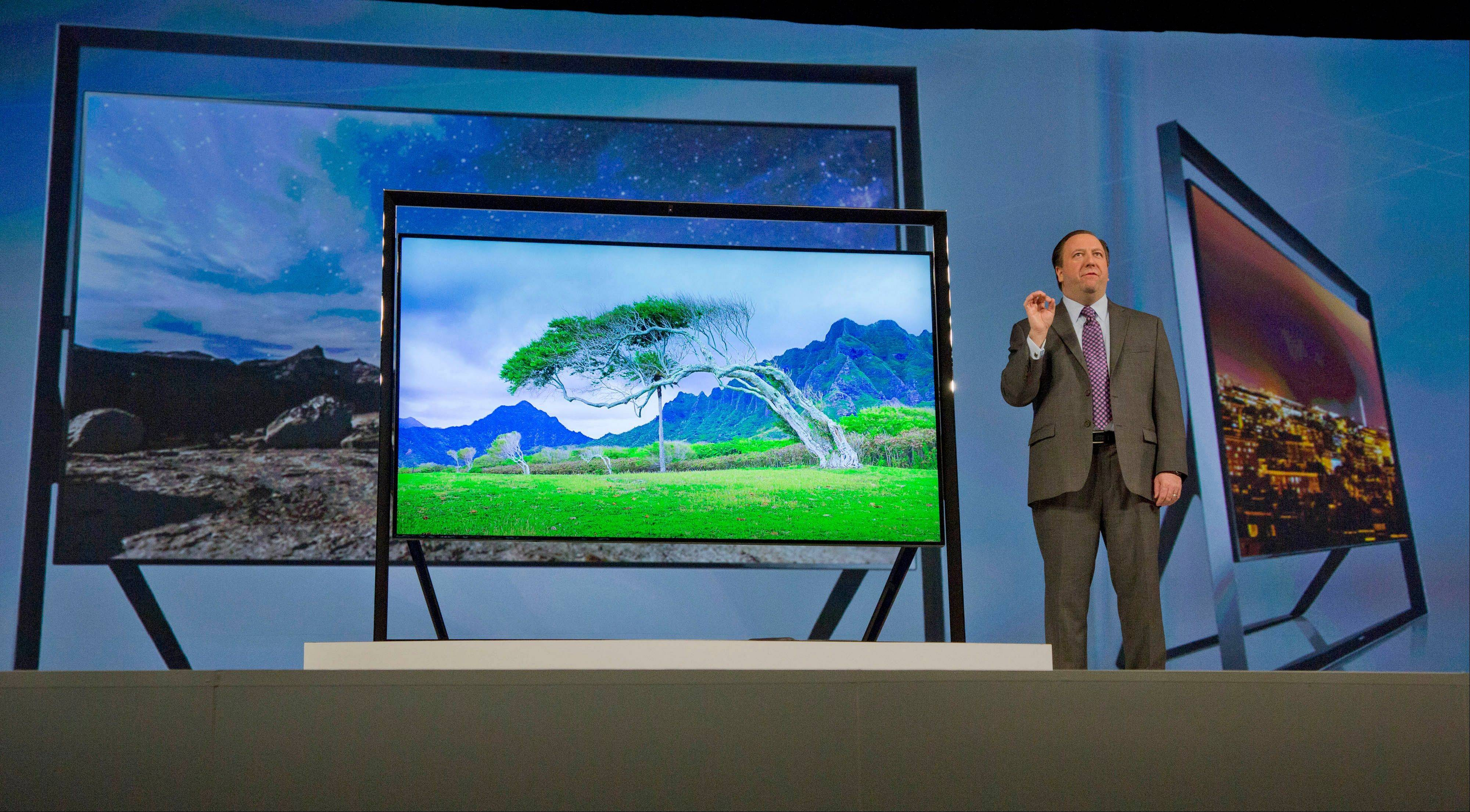 Samsung Electronics executive vice president Joe Stinziano introduces Samsung's Ultra HDTV during a news conference on press day at the Consumer Electronics Show.