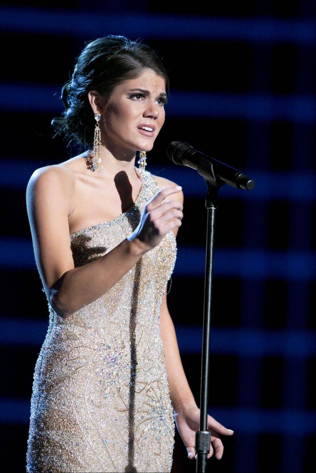 "This photo courtesy Miss America Organization shows Miss Maryland Joanna Guy took top honors Wednesday, Jan. 9, 2013, after singing ""I Dreamed a Dream"" at the Miss America preliminary competition at the Planet Hollywood Resort & Casino in Las Vegas. The 21-year-old from Swanton, Md., will take home a $2,000 Amway scholarship."