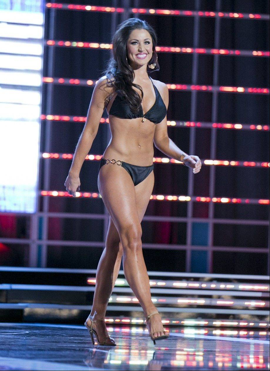 This photo courtesy Miss America Organization shows Miss Illinois Megan Ervin took the trophy for the second round of the Lifestyle and Fitness category Wednesday, Jan. 9, 2013, after modeling a Catalina swimsuit at the Miss America preliminary competition at the Planet Hollywood Resort & Casino in Las Vegas. The 23-year-old from Rushville, Ill., earned a $1,000 Amway scholarship for it.