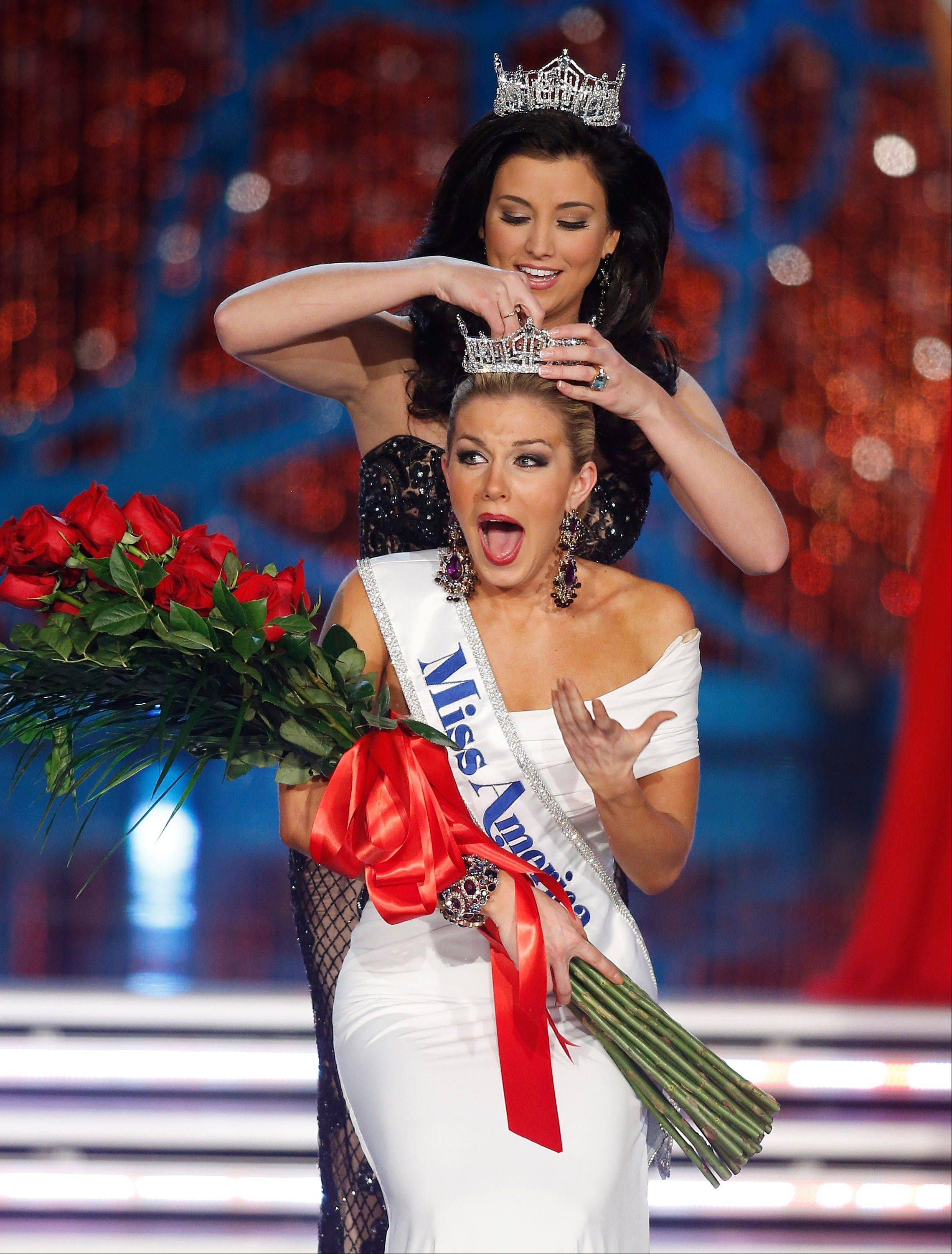 Miss New York Mallory Hagan is crowned Miss America 2013 by Miss America 2012 Laura Kaeppeler on Saturday, Jan. 12, 2013, in Las Vegas.