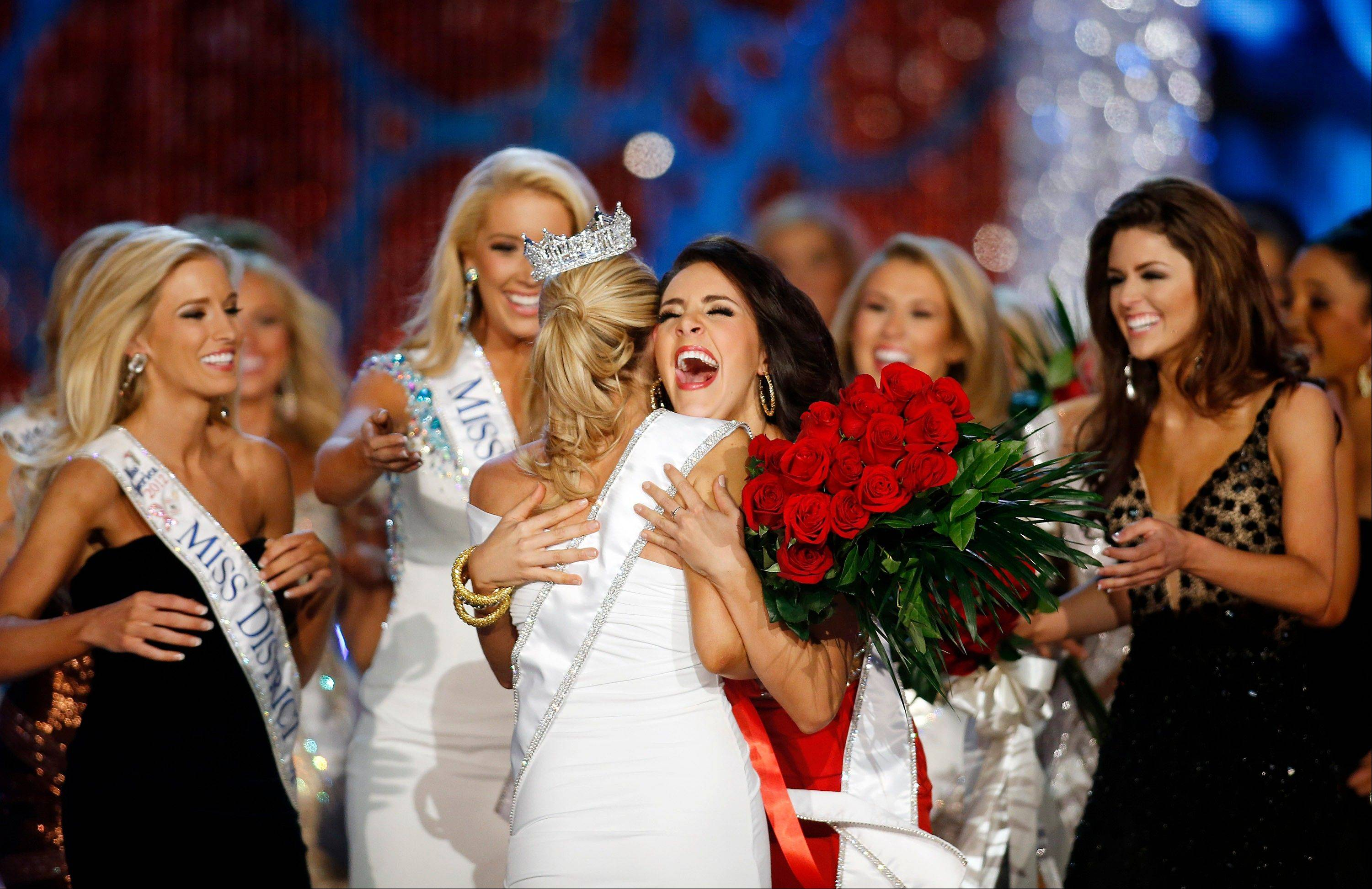 Miss Georgia Leighton Jordan, center, congratulates Miss New York Mallory Hytes Hagan for winning the Miss America 2013 pageant on Saturday, Jan. 12, 2013, in Las Vegas.