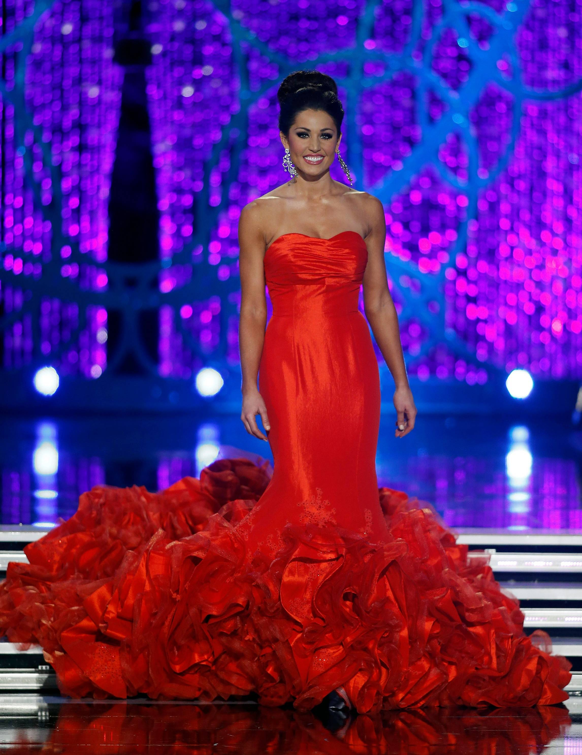 Miss Illinois Megan Irvin competes in the evening gown portion of the Miss America 2013 pageant on Saturday, Jan. 12, 2013, in Las Vegas.