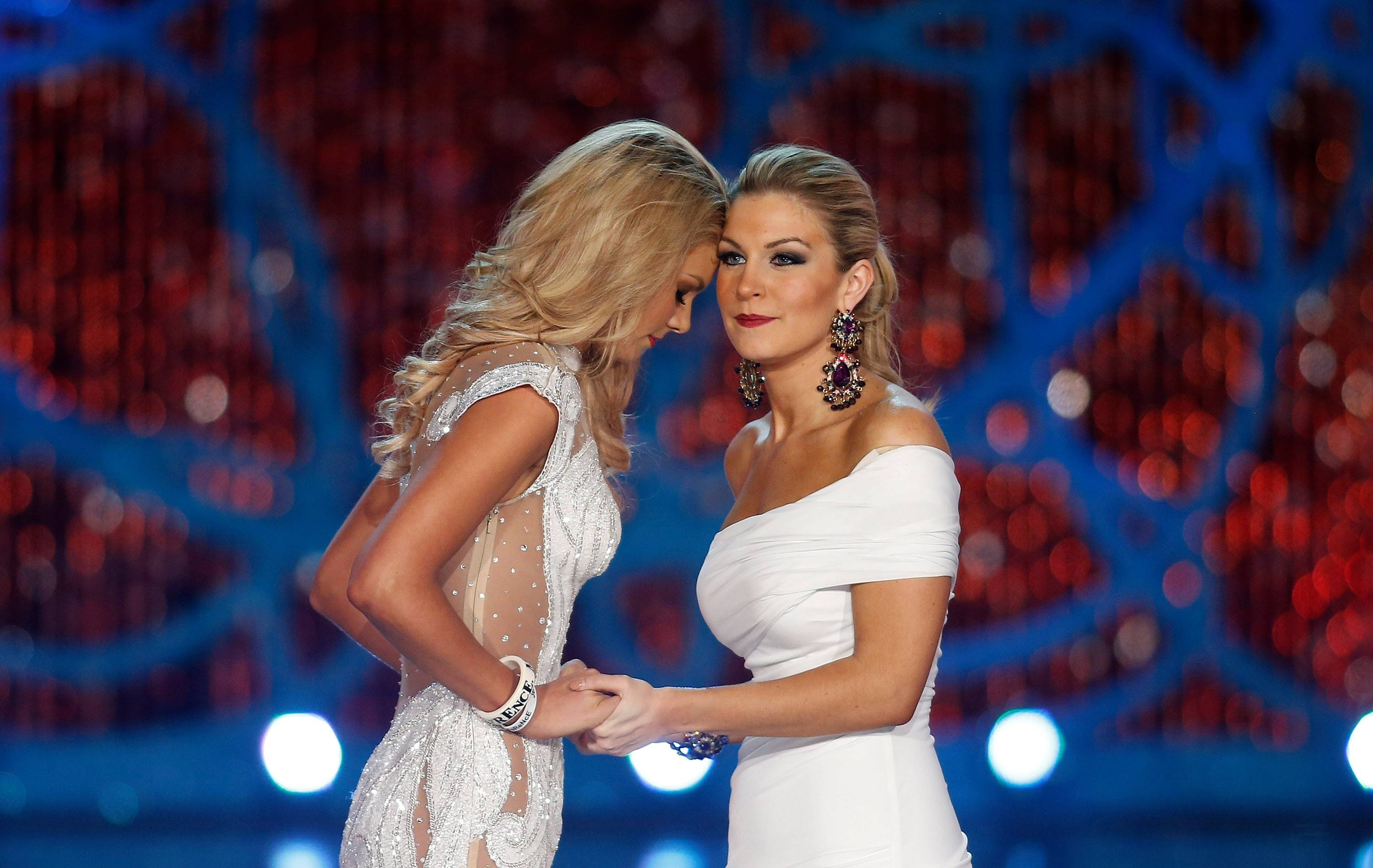 Miss South Carolina Ali Rogers, left, and Miss New York, Mallory Hytes Hagan, right, wait for the announcement of the winner during the Miss America 2013 pageant on Saturday, Jan. 12, 2013, in Las Vegas. Hytes Hagan won the competition.