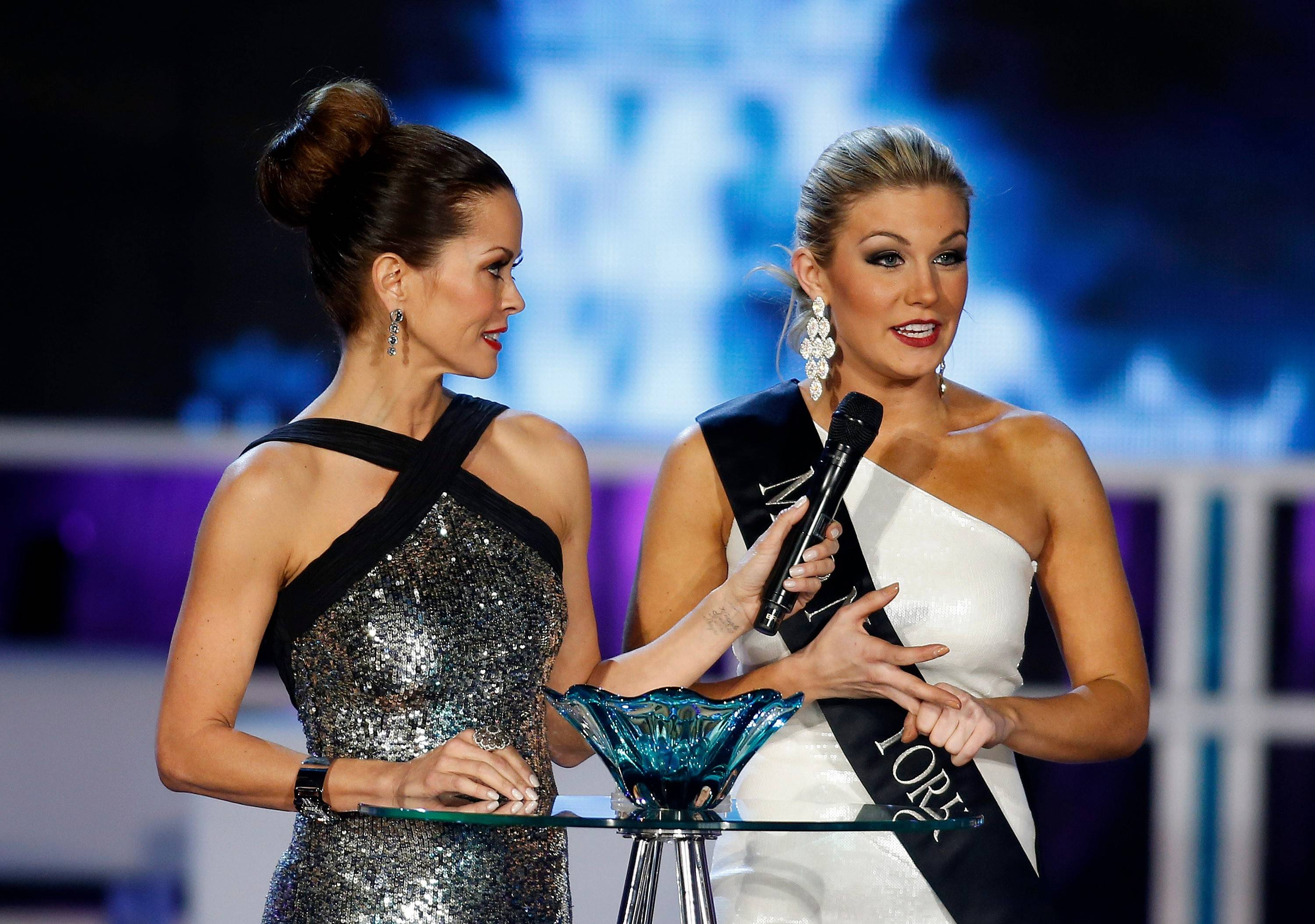 Miss New York Mallory Hytes Hagan, right, answers a question with host Brooke Burke during the Miss America 2013 pageant on Saturday, Jan. 12, 2013, in Las Vegas. Hytes Hagan was later crowned Miss America 2013.