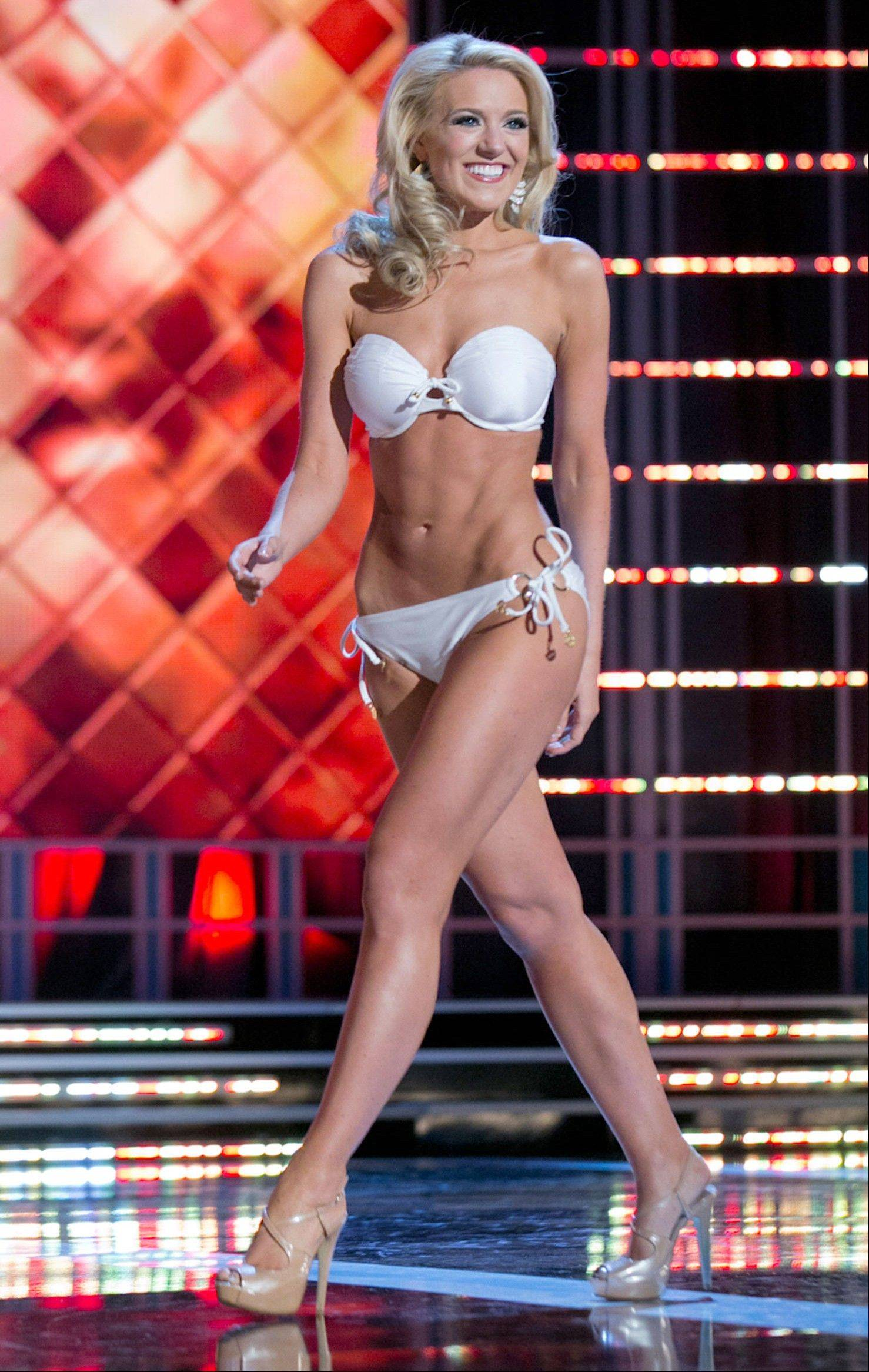 This photo courtesy Miss America Organization shows Miss Washington Mandy Schendel who took the trophy for the third round of the Lifestyle and Fitness category after modeling a strapless white Catalina swimsuit on Thursday. Jan. 10, 2013, at the Planet Hollywood casino in Las Vegas. The 22-year-old from Newcastle, Wash., earned a $1,000 Amway scholarship for it.