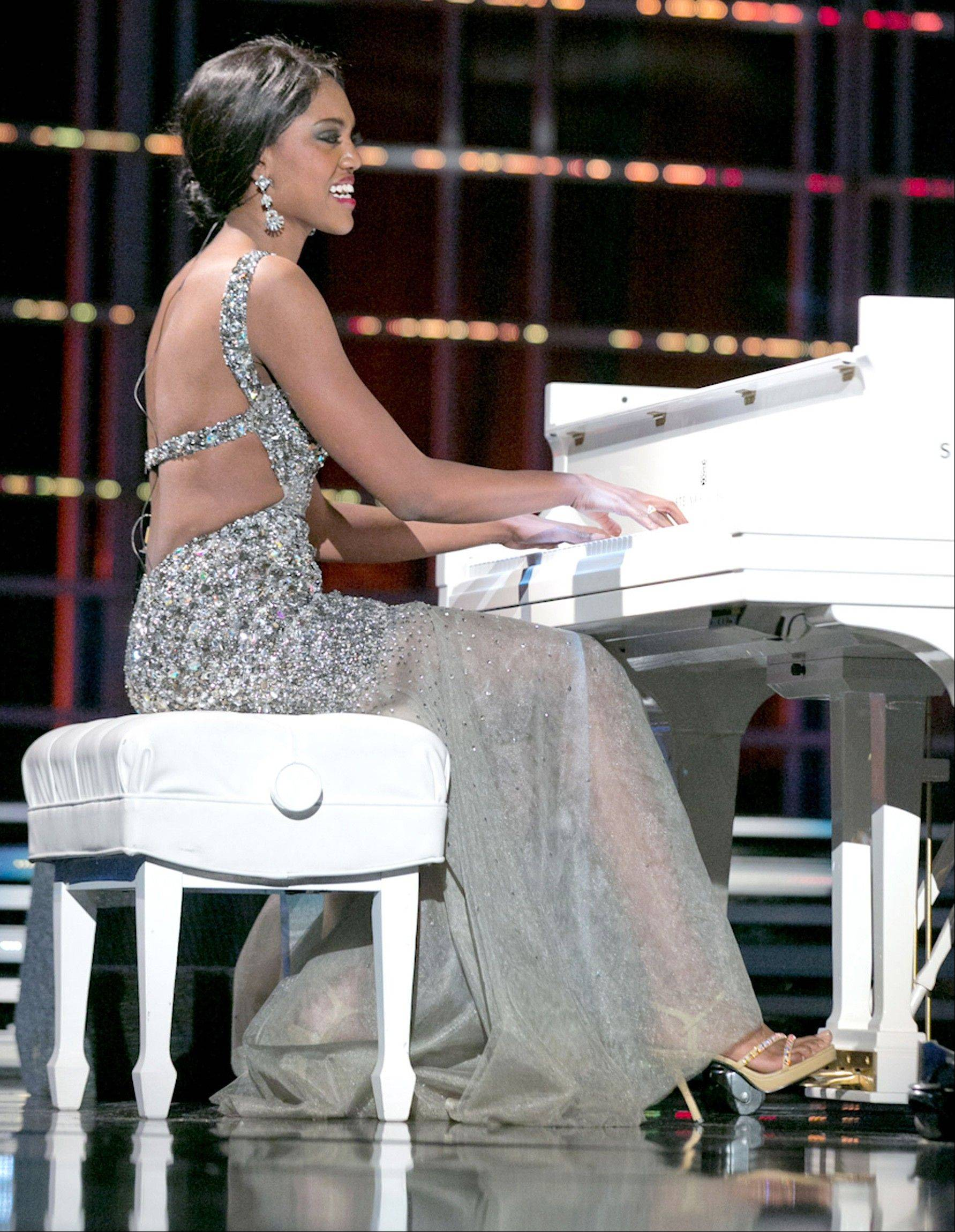 "This photo courtesy Miss America Organization shows Miss North Dakota Rosie Sauvageau took top honors Thursday, Jan. 10, 2013, after her piano and vocal rendition of ""To Make You Feel My Love."" The 24-year-old from Fargo, N.D., will take home a $2,000 Amway scholarship from the competition at Planet Hollywood resort in Las Vegas."