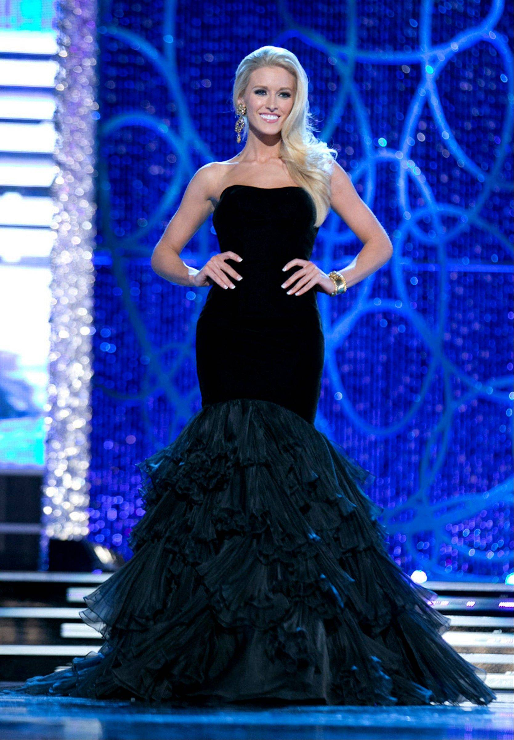 This photo courtesy Miss America Organization shows Miss DC, Allyn Rose, during the Evening Wear portion of preliminary competition at the 2013 Miss America Pageant in Las Vegas, Tuesday, Jan. 8, 2013. Win or lose, Saturday's Miss America competition will be Rose's last pageant. The 24-year-old plans to undergo a double mastectomy after the event as a preventative measure to reduce her chances of developing the disease that killed her mother, grandmother and great aunt.