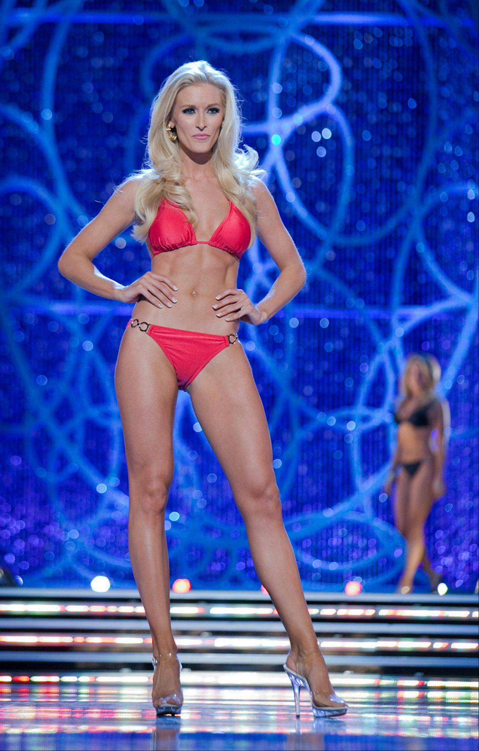 This photo courtesy Miss America Organization shows Miss DC, Allyn Rose, during the Swimsuit portion of preliminary competition at the 2013 Miss America Pageant in Las Vegas, Tuesday, Jan. 8, 2013.