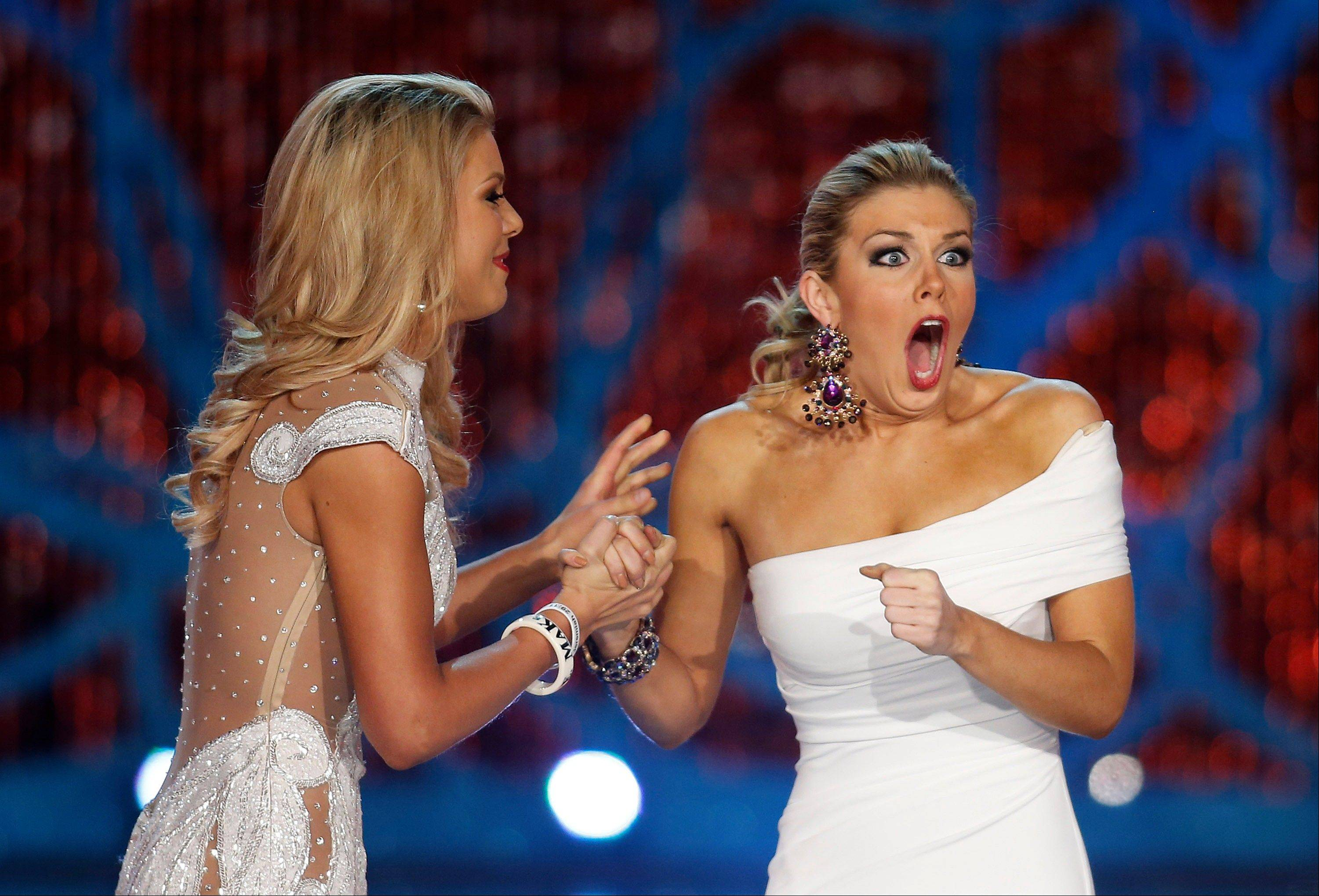 Miss New York, Mallory Hagan, right, reacts with Miss South Carolina Ali Rogers as she is crowned Miss America 2013 on Saturday, Jan. 12, 2013, in Las Vegas.