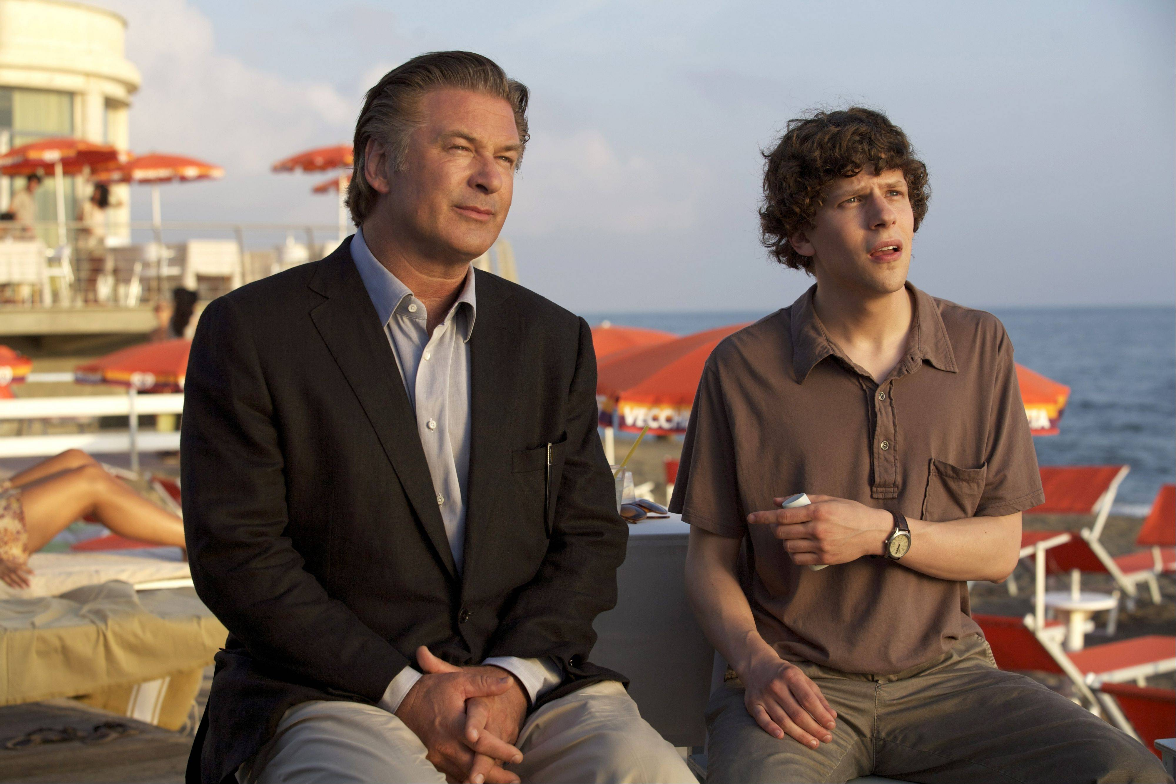 "John (Alec Baldwin) becomes a mentor to young Jack (Jesse Eisenberg) in one of four subplots juggled by writer/director Woody Allen in ""To Rome With Love."""