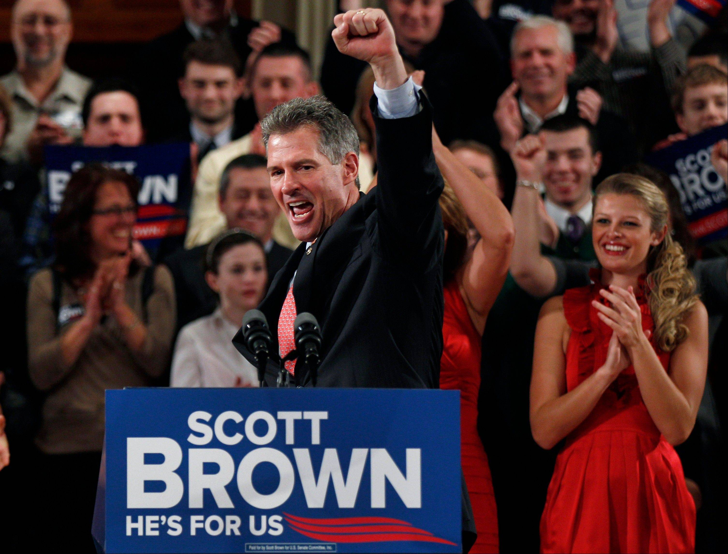 Then Massachusetts Republican Sen. Scott Brown pumps his fist during his re-election campaign kick-off in Worcester, Mass.
