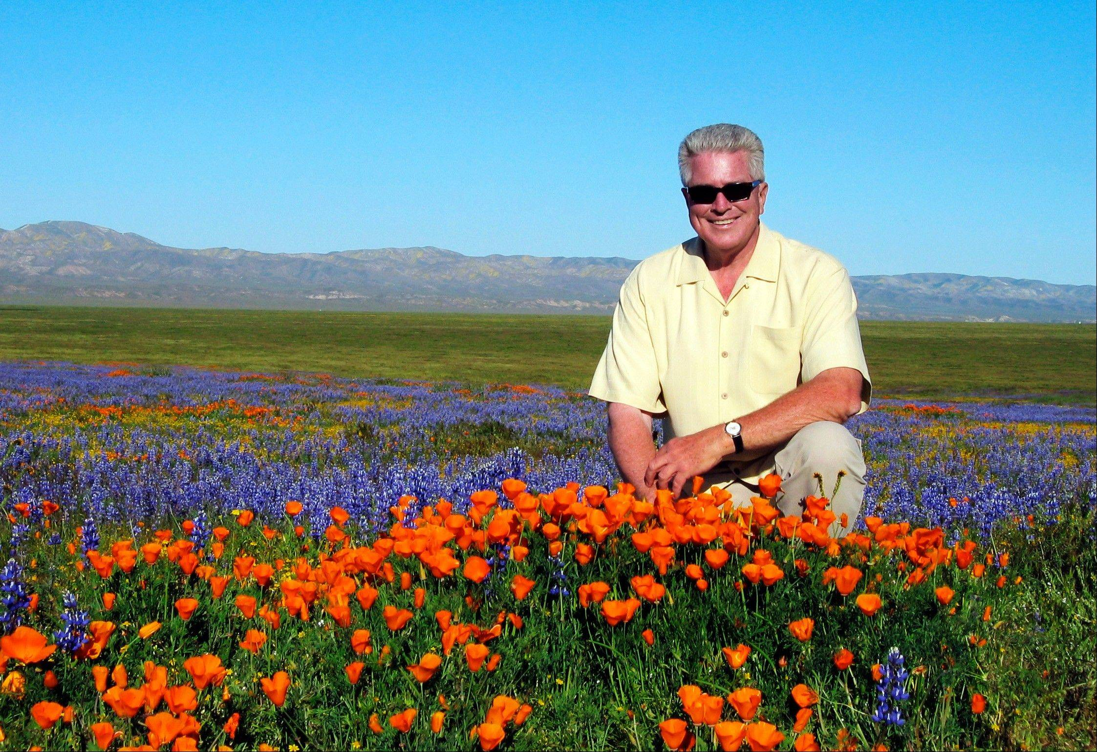 Television host Hull Howser poses for a photo at the Antelope Valley California Poppy Reserve in Lancster, Calif.