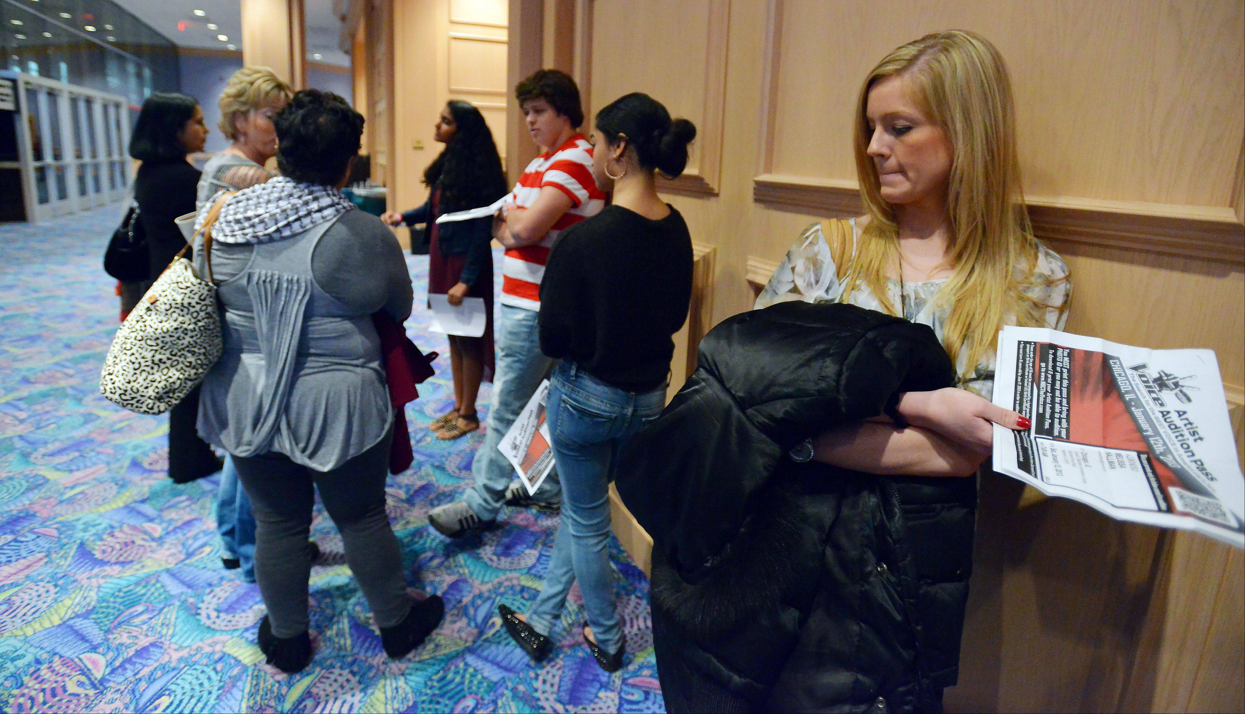 "Melissa Hallman, 25, of Barrington appears nervous as she stands in one of many lines with other singers during Saturday morning auditions for NBC's ""The Voice"" at the Donald E. Stephens Convention Center in Rosemont."
