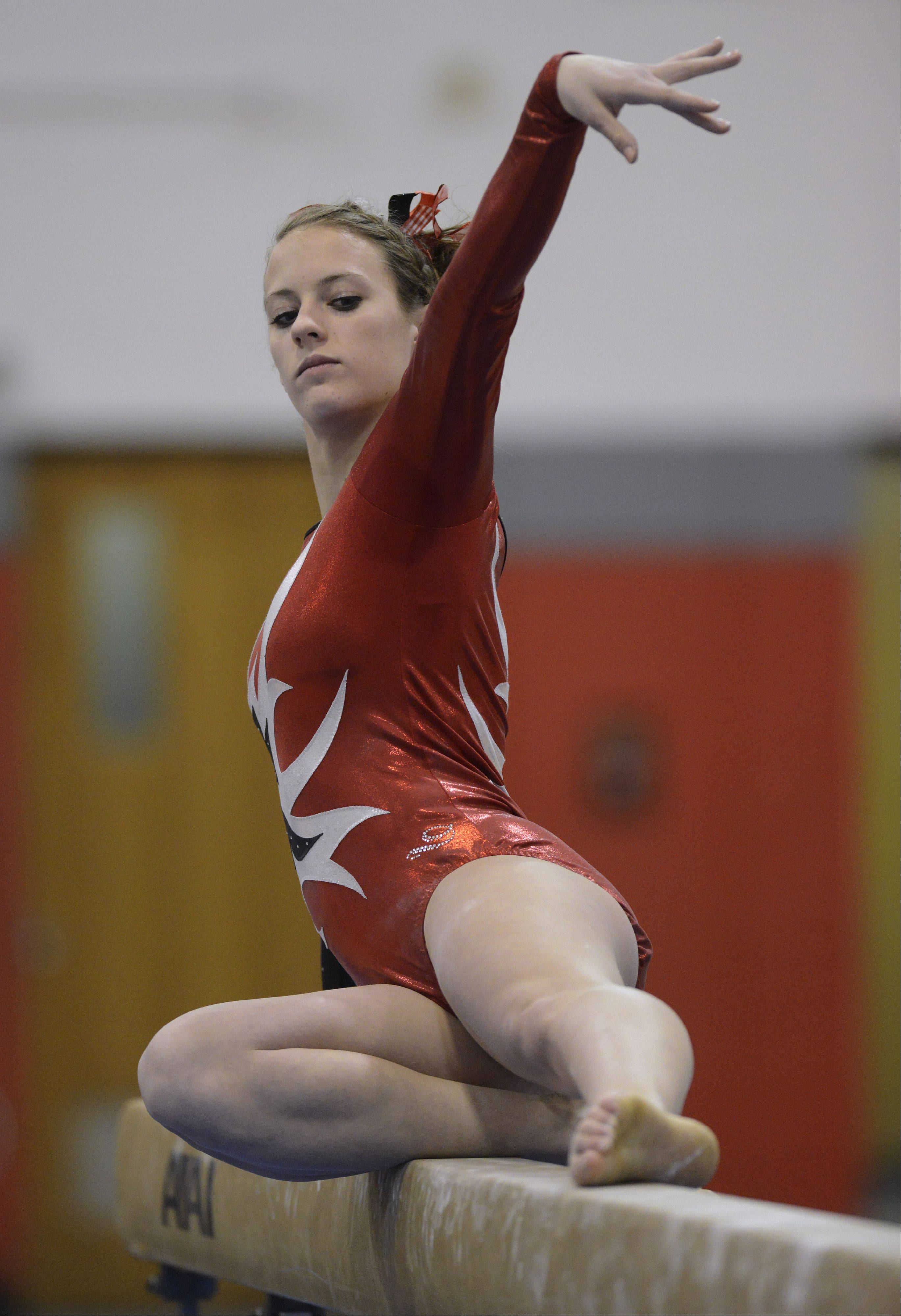 Barrington's Molly Blanke competes on balance beam during the Lake County girls gymnastics meet at Mundelein on Saturday.