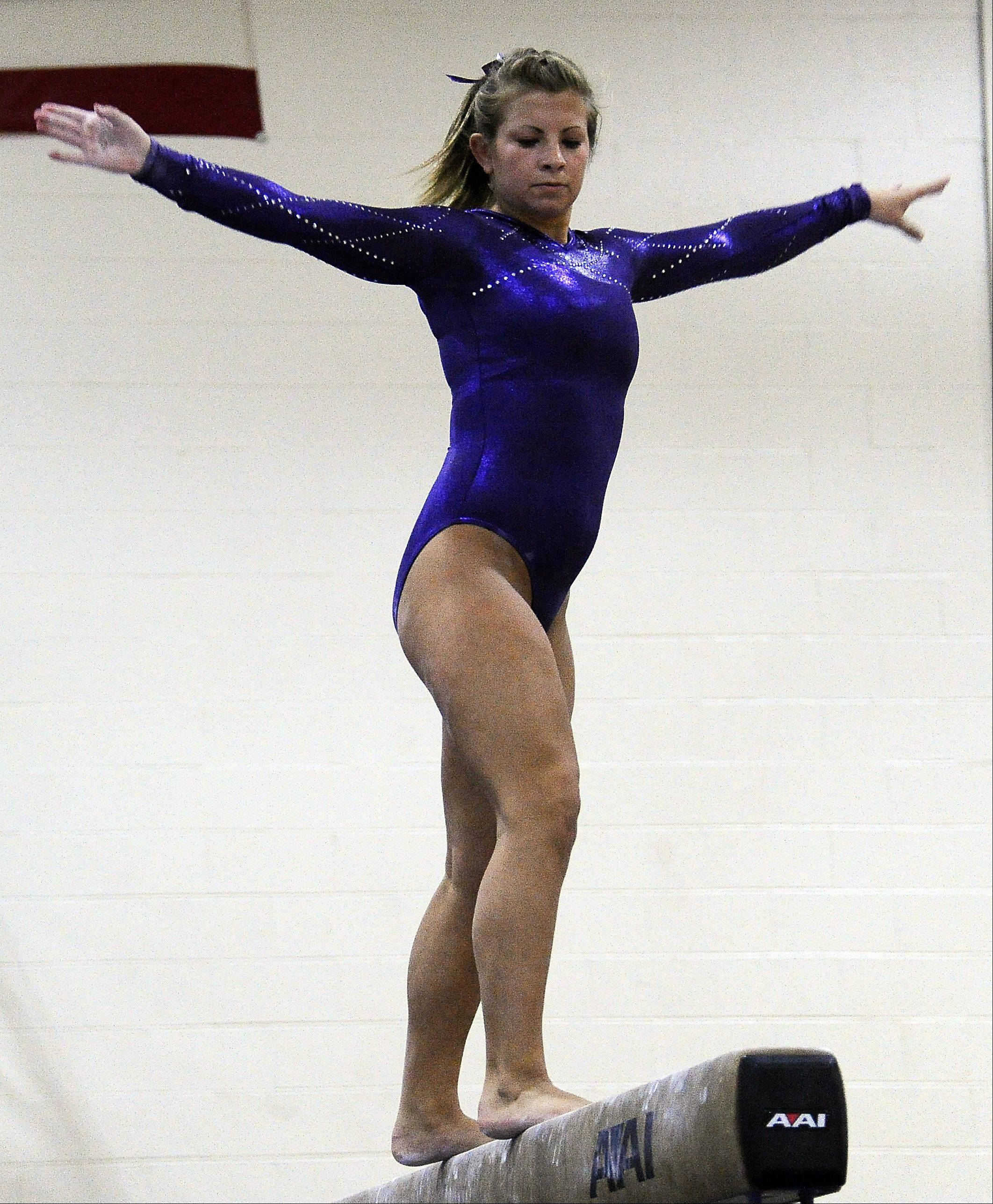 St. Charles' Kelly Gorniak on the balance beam at the Fremd Invitational on Saturday.