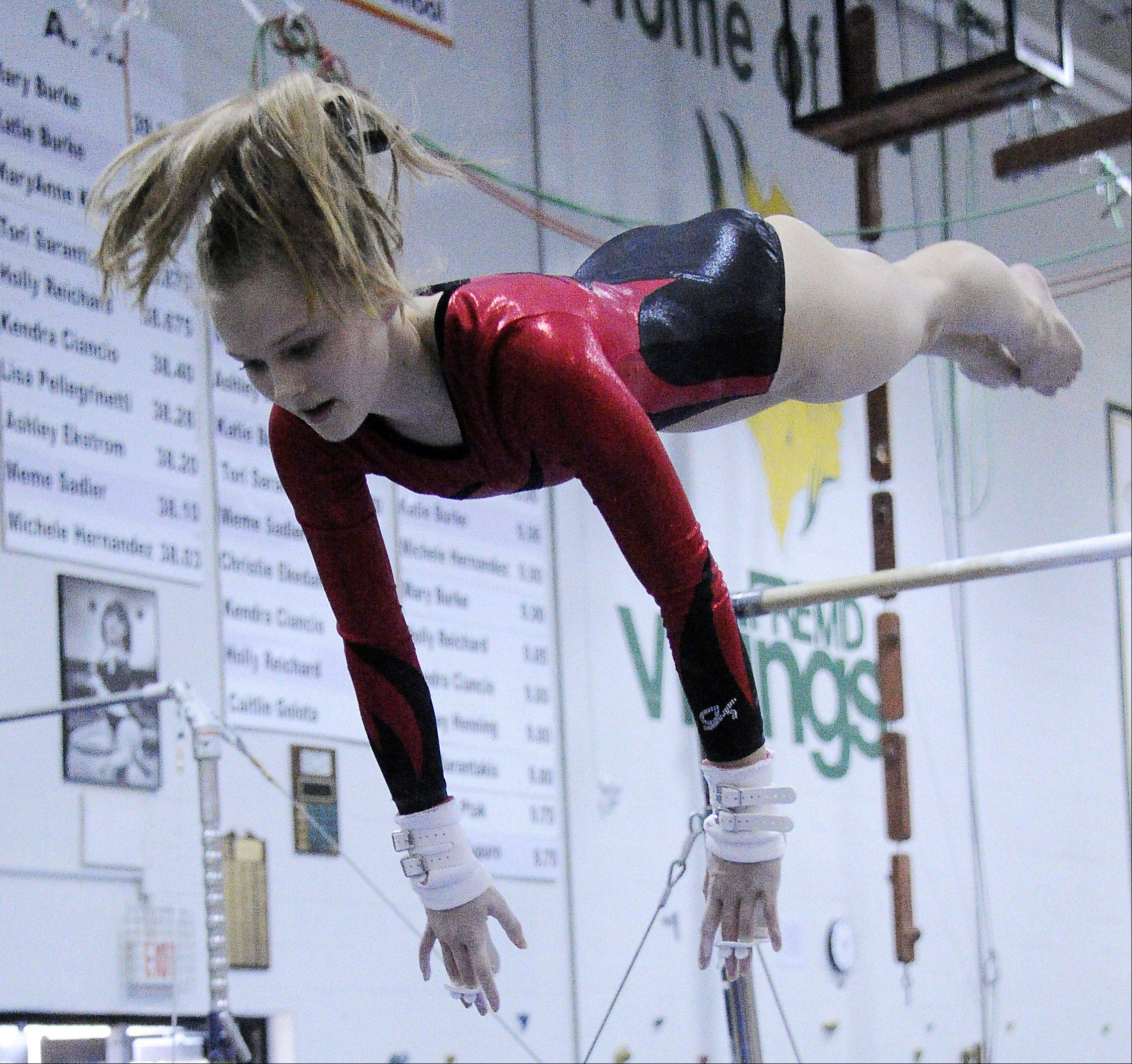 Naperville Central's Vanessa Henry on her bars dismount at the Fremd Invitational on Saturday.