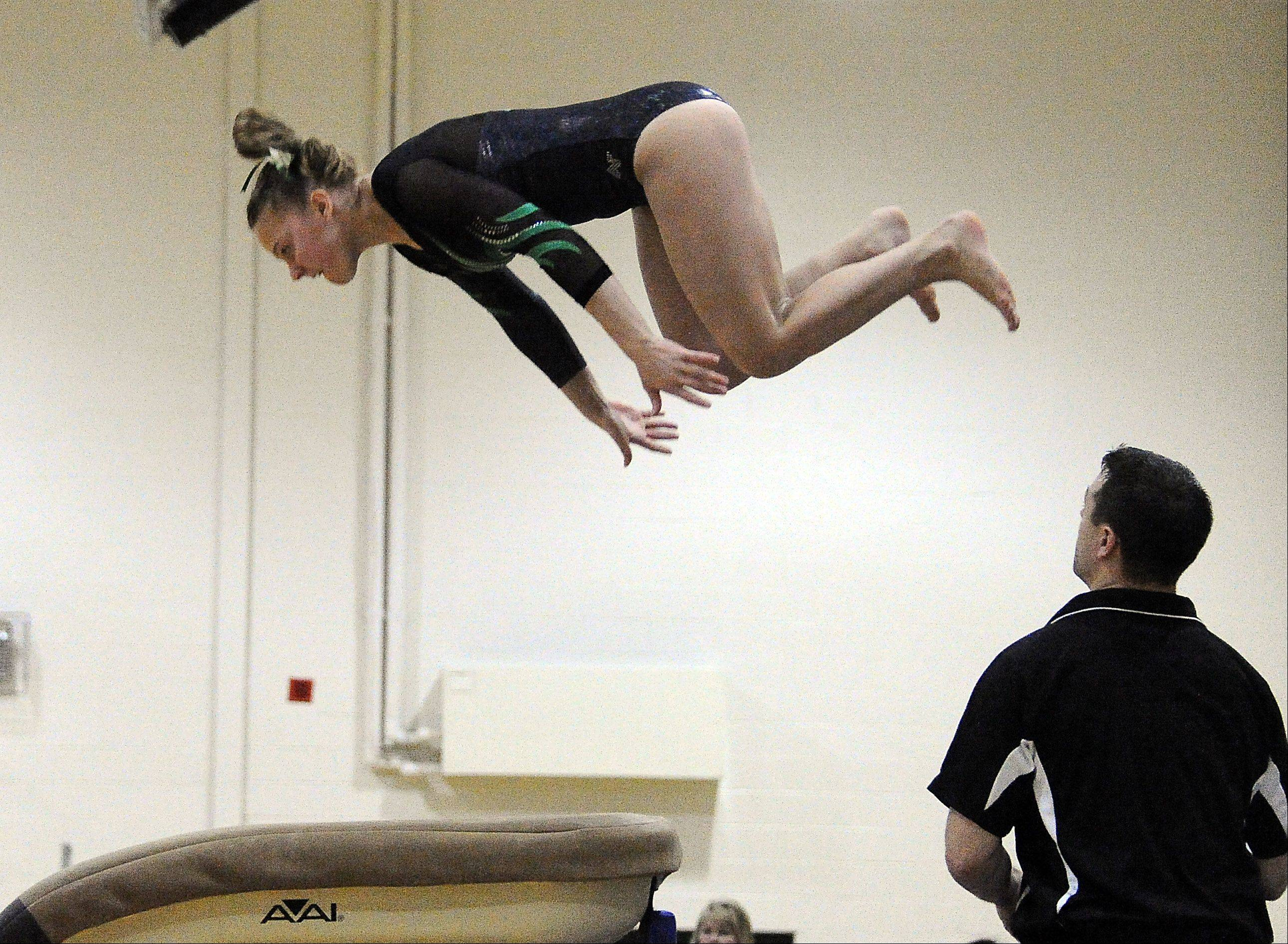 Fremd's Lisa Radochonski on the vault at the Fremd Invitational on Saturday.