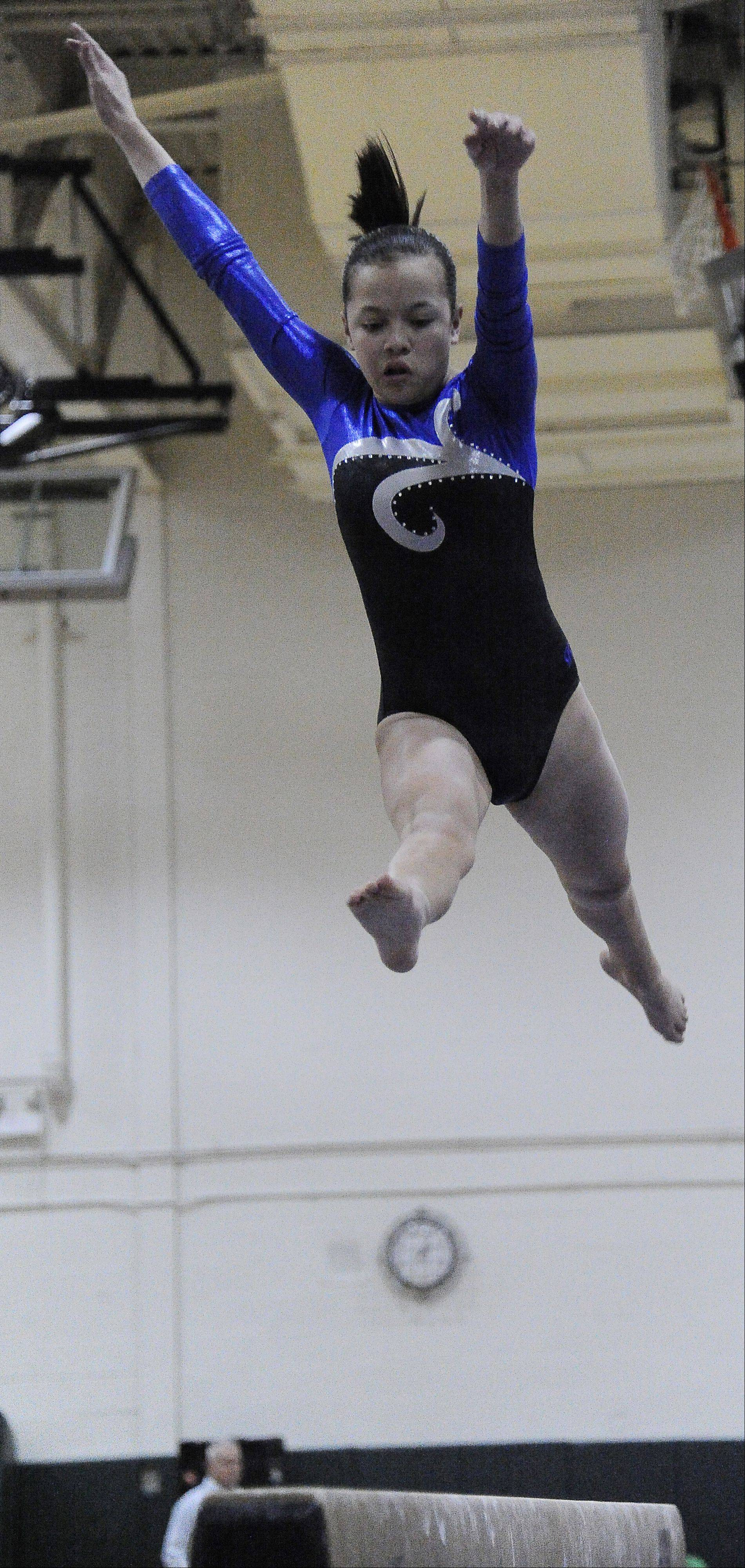 Emily Tom of Downers Grove South on the beam at the Fremd Invitational on Saturday.