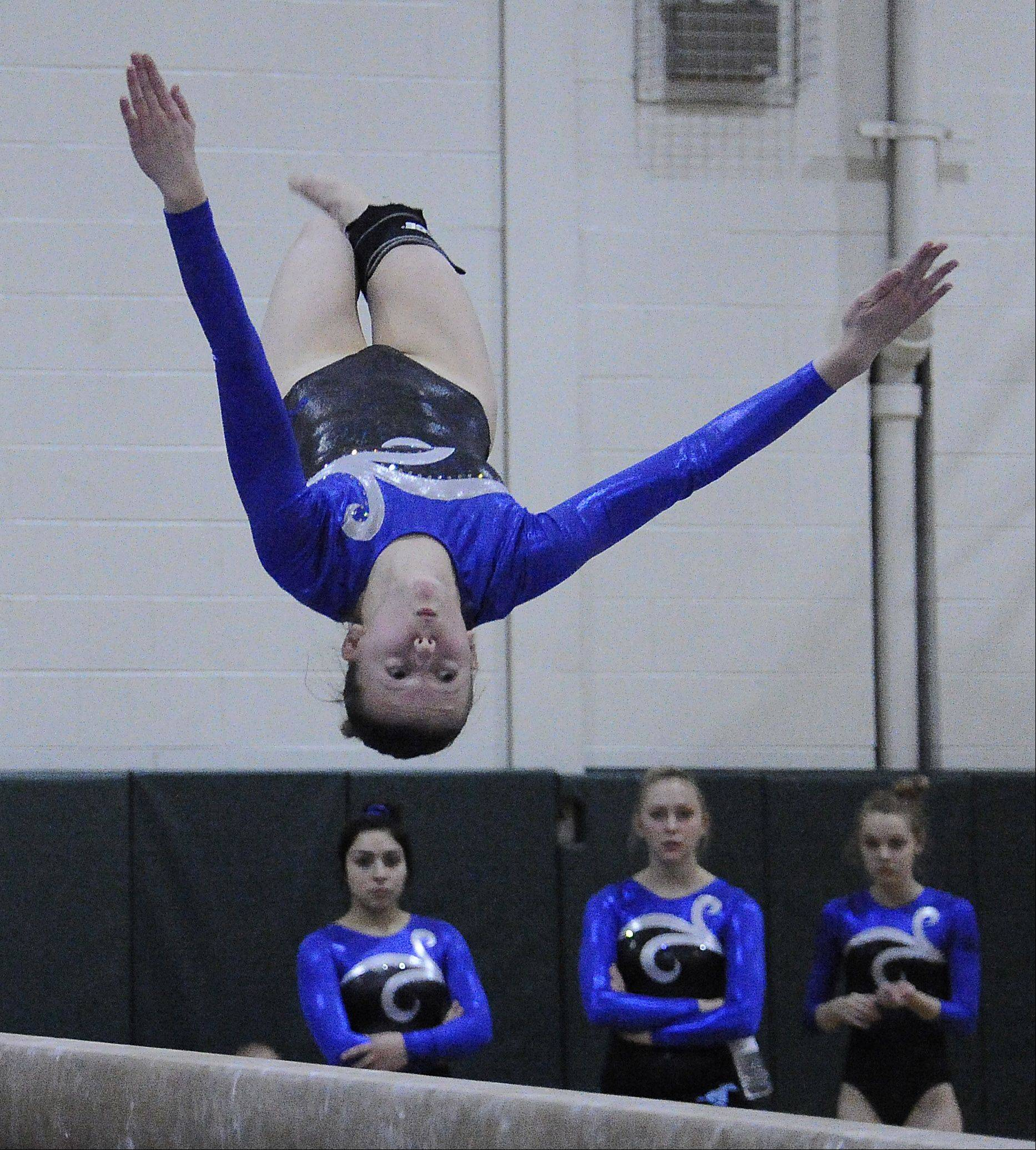 Inna Dzyumma of Downers Grove South on the beam at the Fremd Invitational on Saturday.