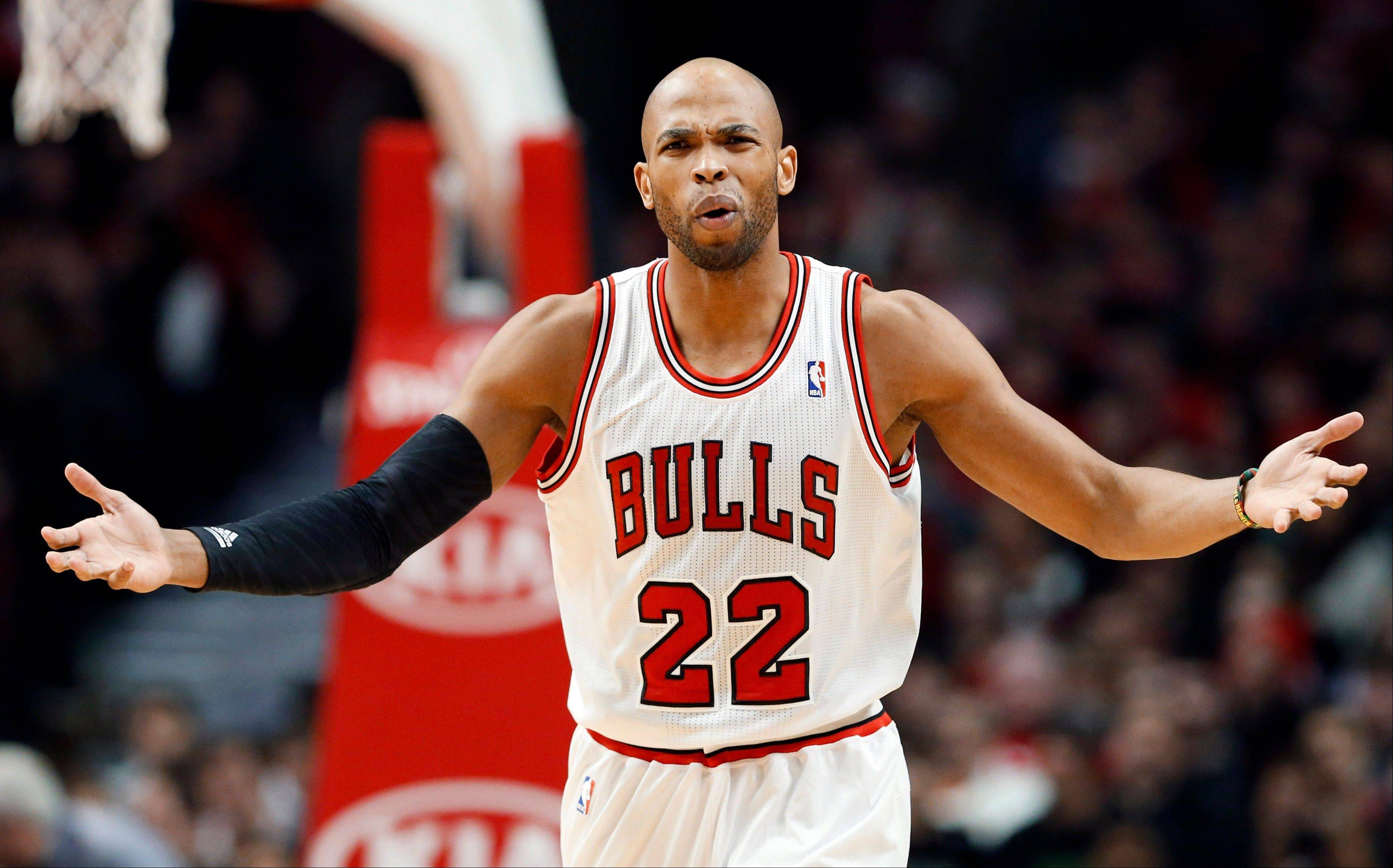 Chicago Bulls forward Taj Gibson reacts to a call during the first half of an NBA basketball game against the Phoenix Suns in Chicago on Saturday, Jan. 12, 2013.