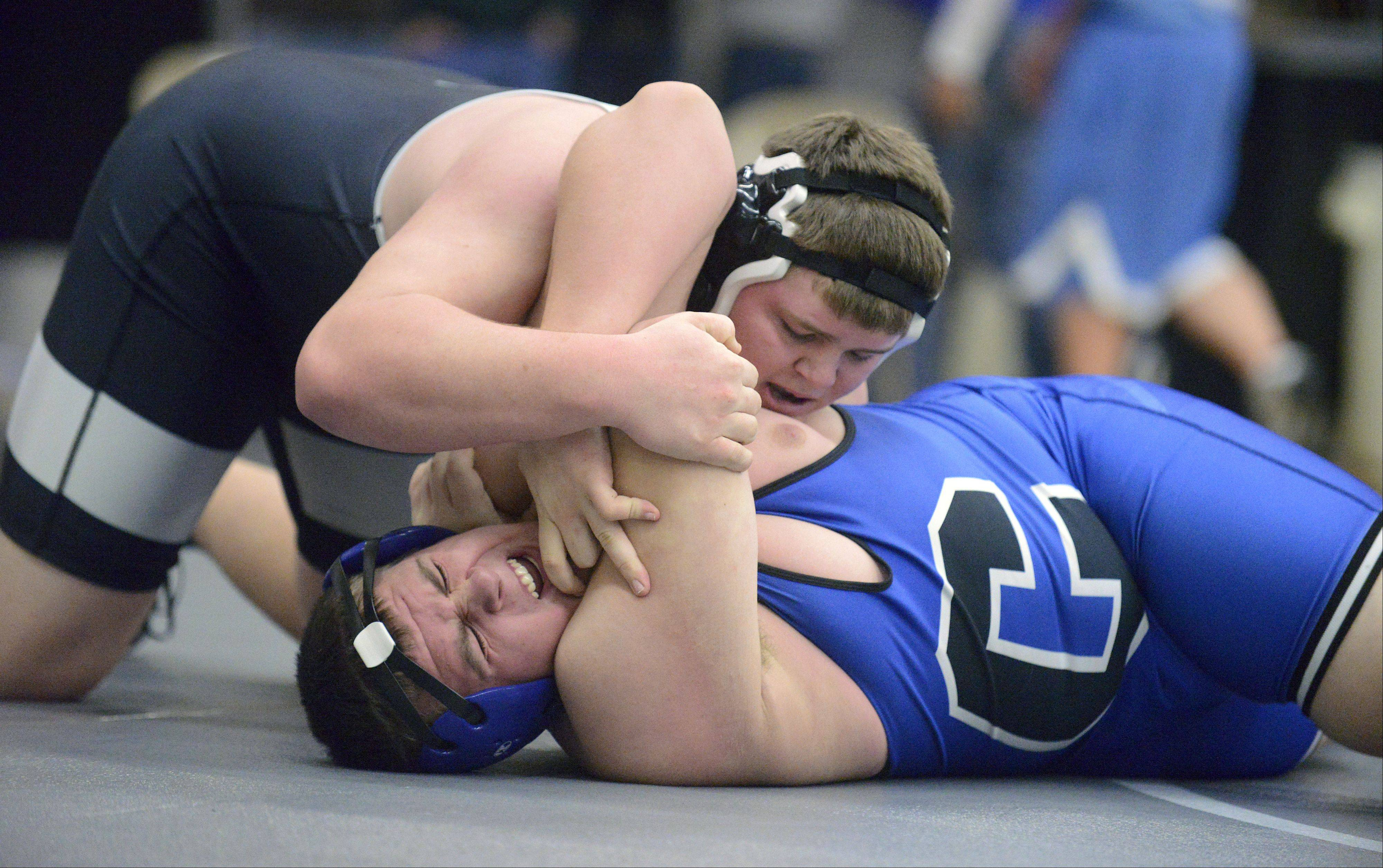 Laura Stoecker/lstoecker@dailyherald.comKaneland's Justin Diddell takes Burlington-Central's Matt Overstreet in the 285 pound match on Saturday, January 12.