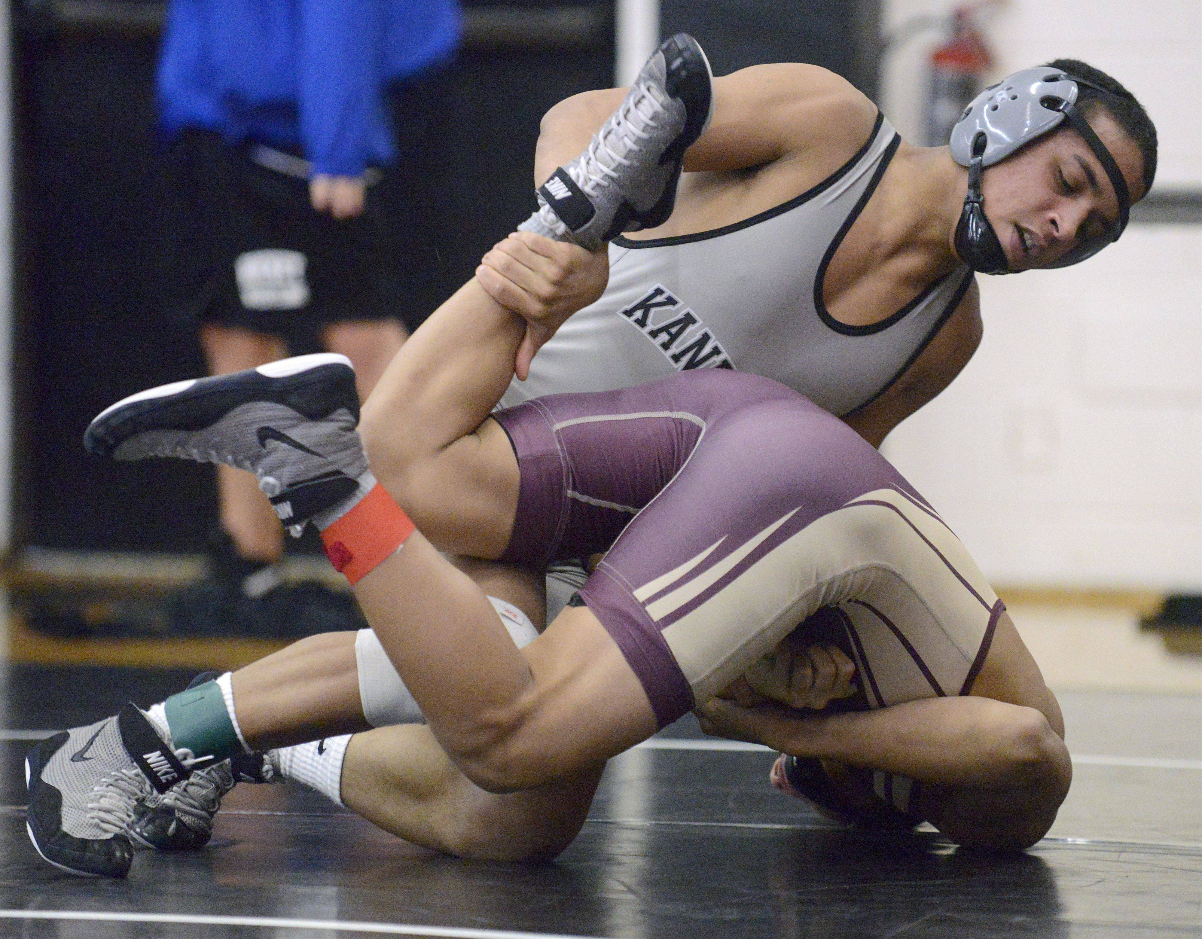 Kaneland's Esai Ponce takes the 132 pound match over Elgin's Nathaniel Romero on Saturday, January 12.